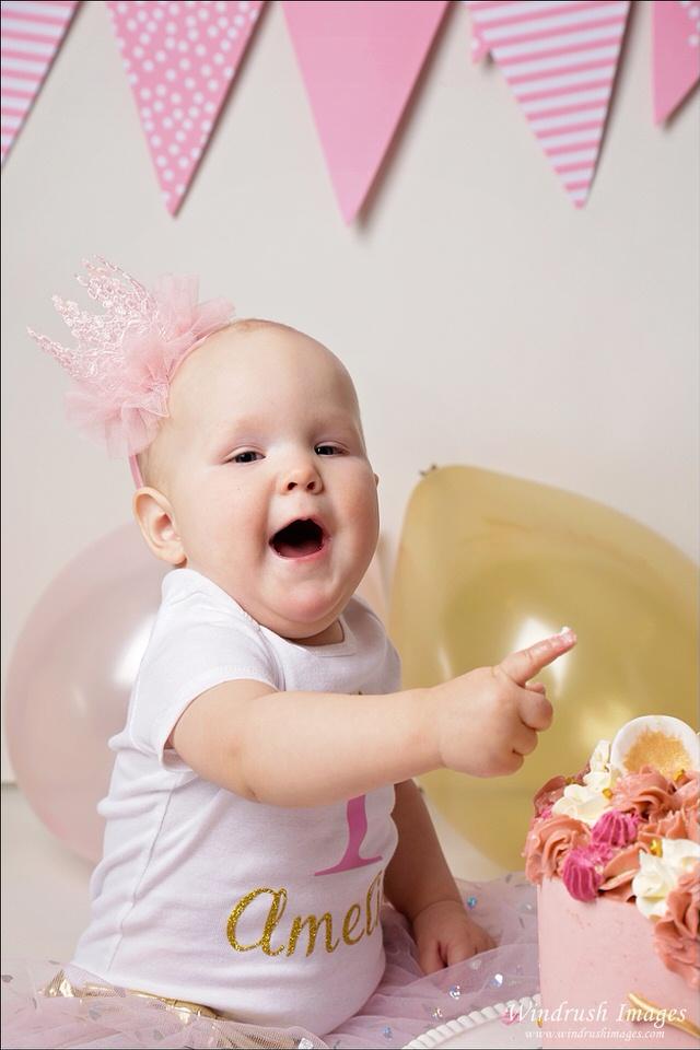 happy-little-girl-at-best-unicorn-cake-smash-photos-Calgary