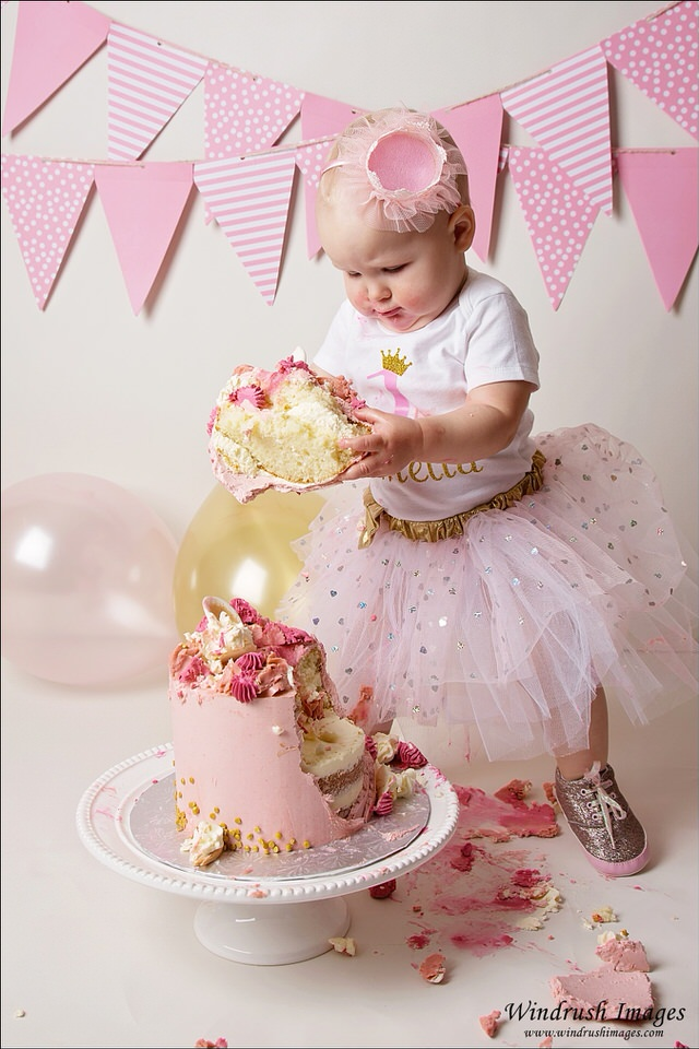 pink-and-white-cake-smash-with-balloons-Calgary-one-year-old-photos
