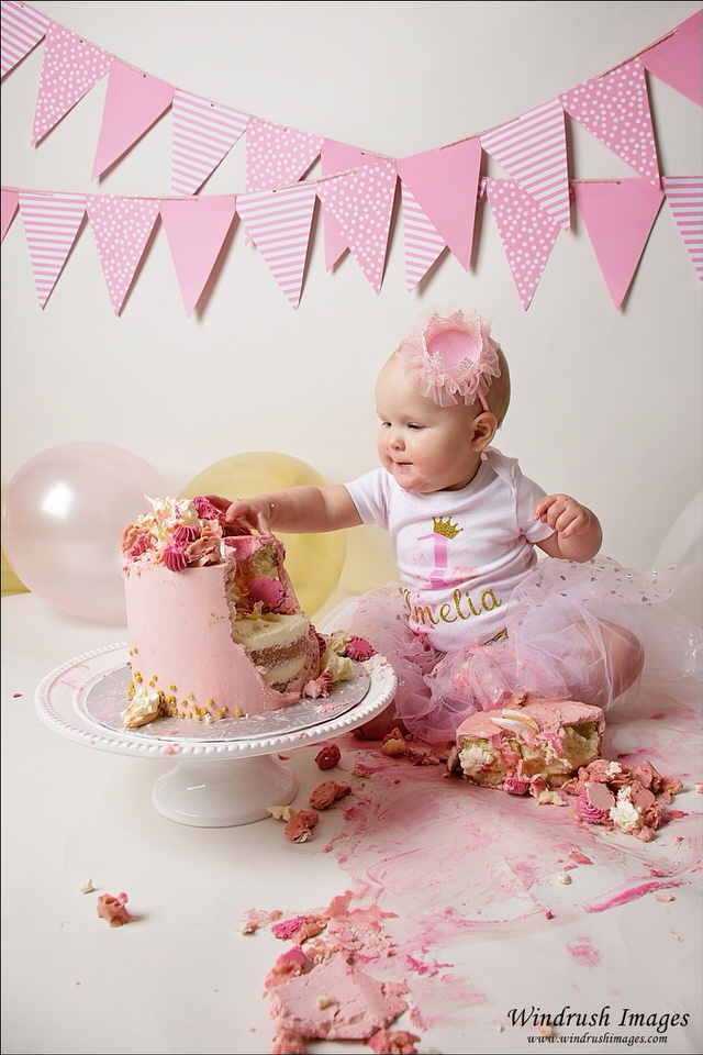 baby-girl-enjoying-cake-smash-photos-Calgary