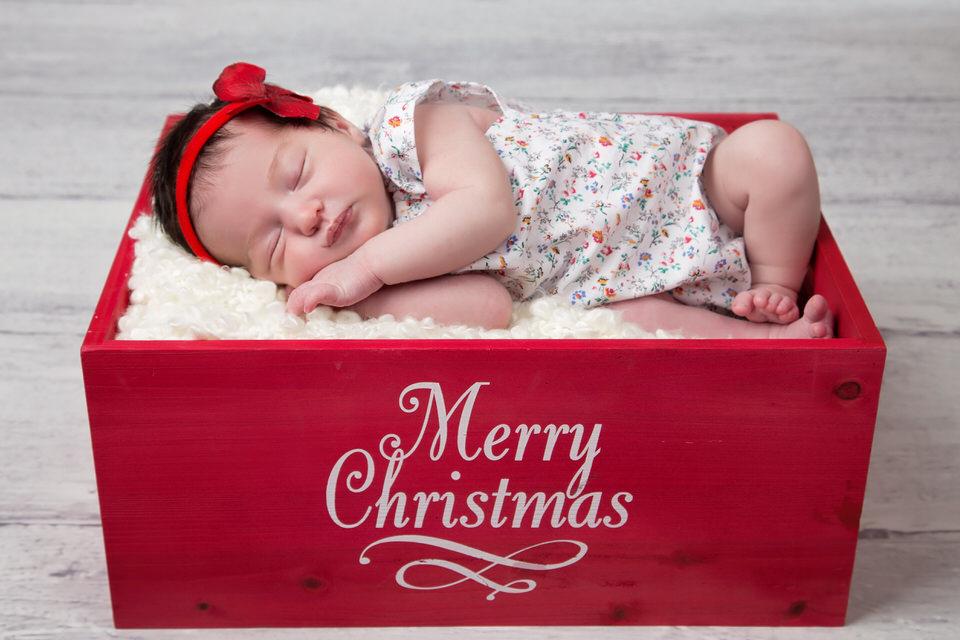 Newborn-baby-girl-sleeping-in-red-Christmas-box-Calgary-newborn-photographer.jpg
