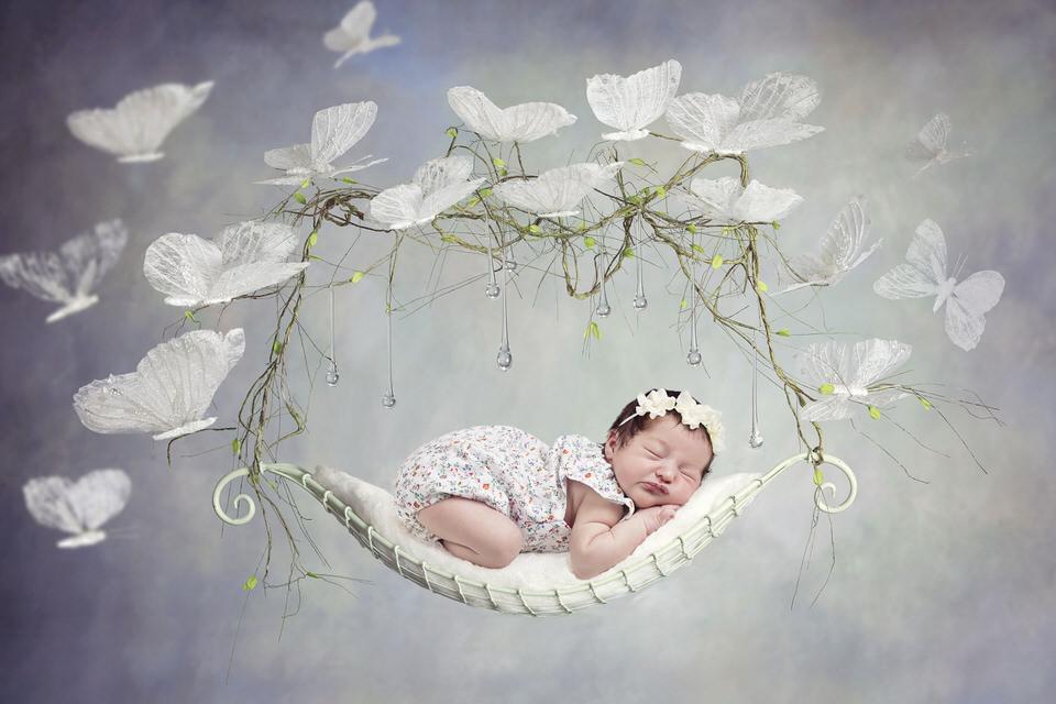 newborn-baby-girl-wit-butterflies-newborn-photos-Calgary.jpg