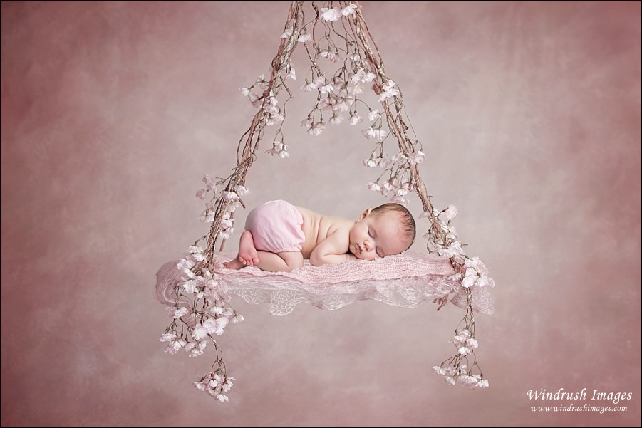 newborn-baby-girl-on-flower-swing-newborn-photography-Calgary-NW.jpg