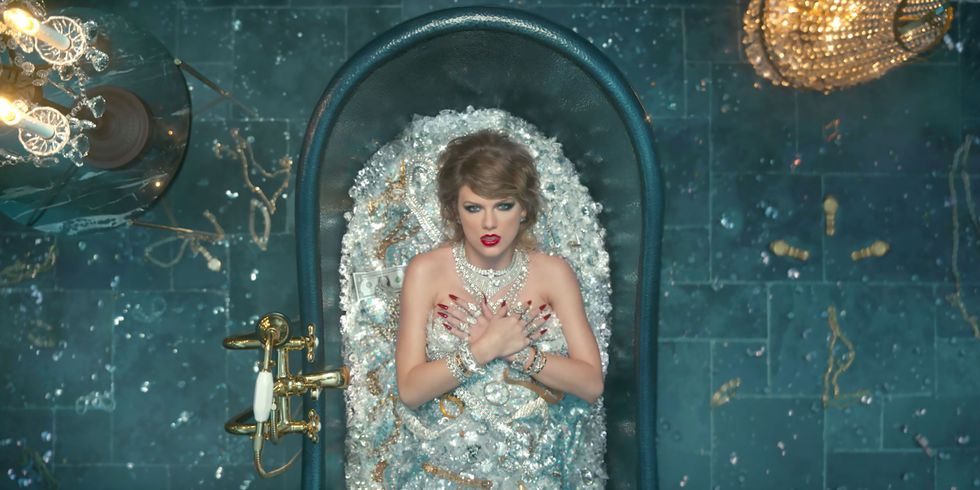 "Photo: Screenshot from Taylor Swift's "" Look What You Made Me Do "" music video on  youtube.com. Drowning in diamonds; a classic pop culture representation of excess."