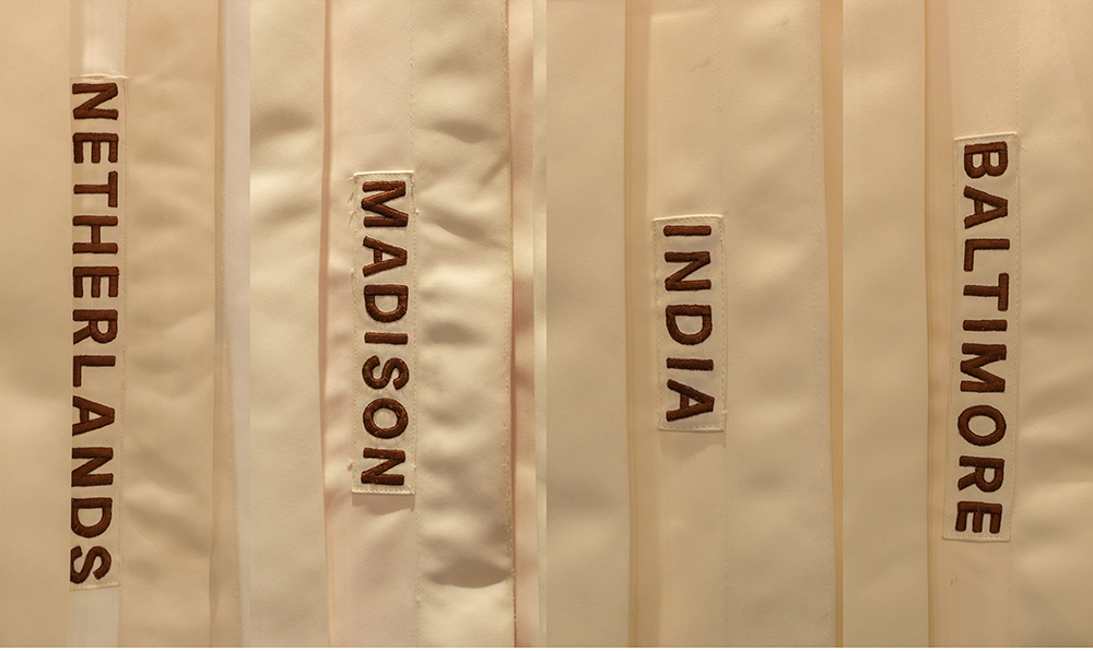 The labels signify the different experiences that communicate to the audience that there is variety and that they can make a choice. The pleats on the outer surface of the tent add a pleasant visual pattern. The hand-embroidered labels on the tents add a subtle layer of information while maintaining its tactile nature.