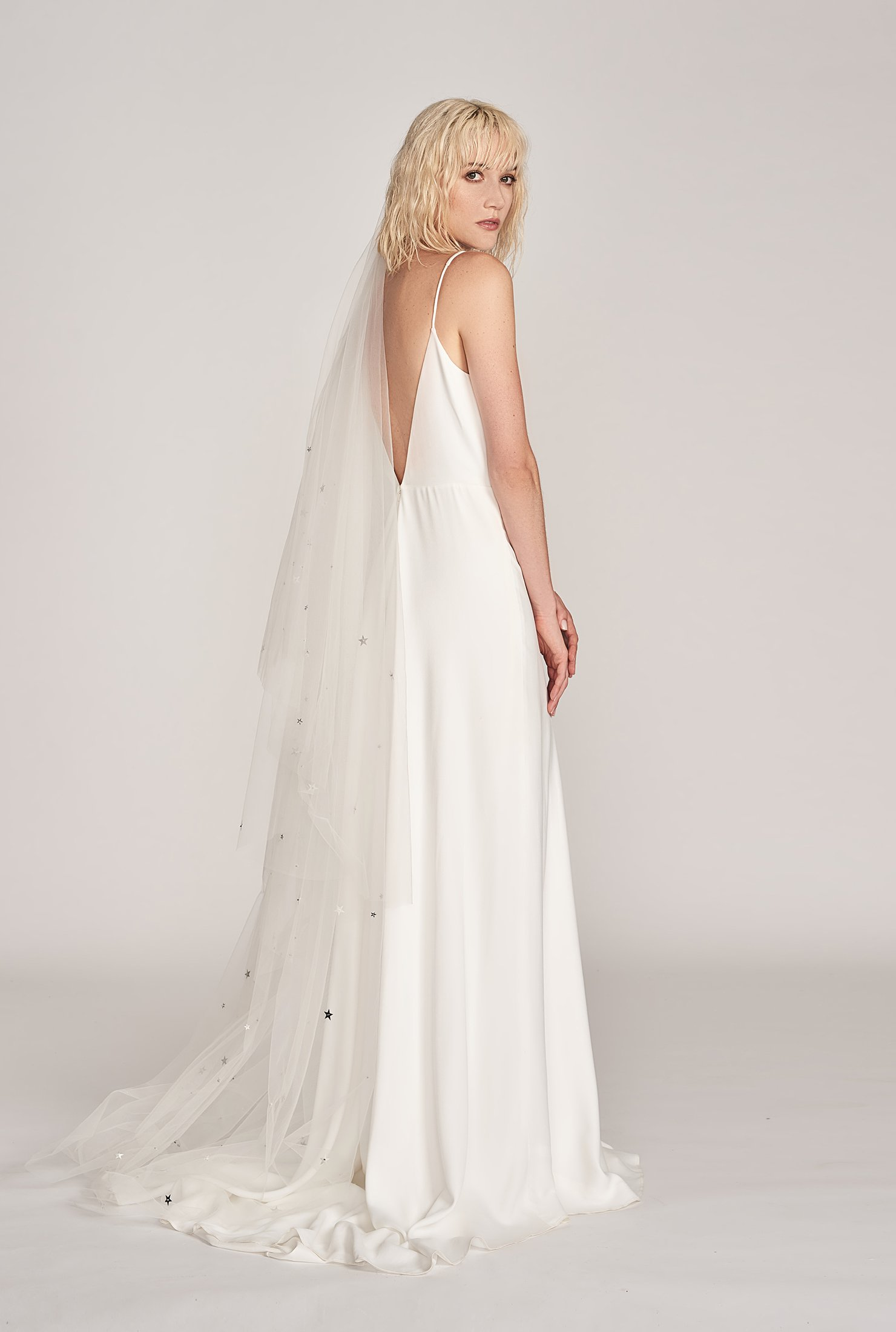 Charlie Brear Fernley Gown, $3250,  Through The White Door,  Dove Grey Bridal Star Drop Veil, $520,   Hope X Page  .