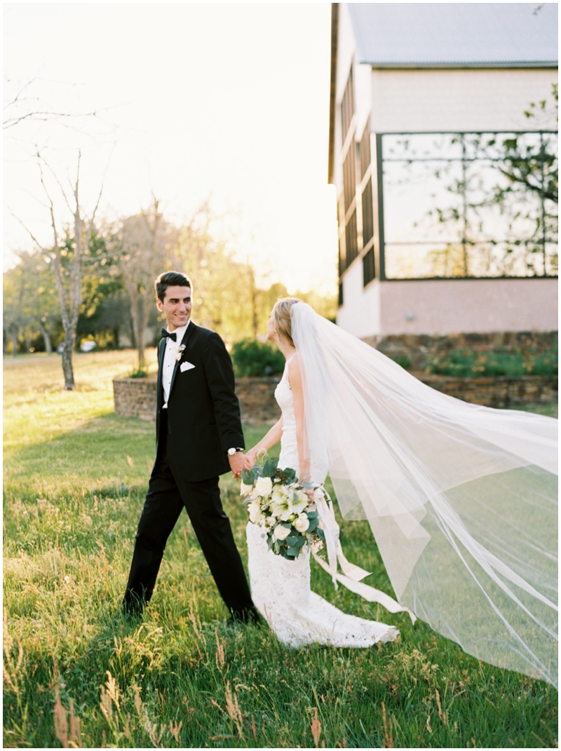 The most epic veil picture at this classic black tie wedding  by Top Texas Wedding Photographer Hannah Mayson