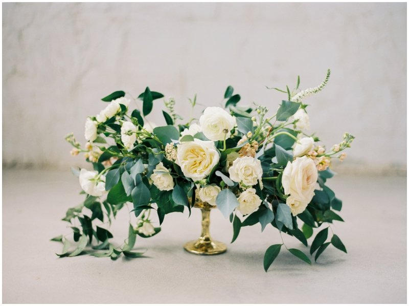 Overflowing neutral bouquet against textured backdrop  by Top Texas Wedding Photographer Hannah Mayson