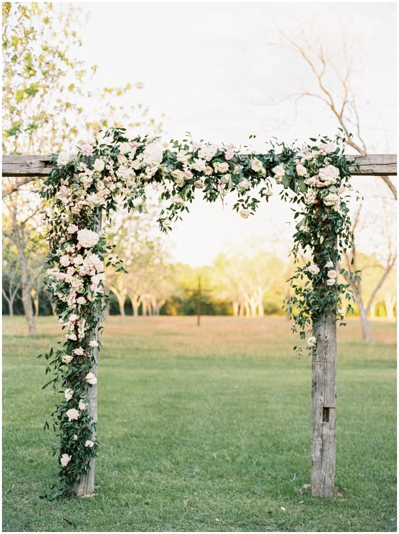 DIY Flower Arch with Beautiful Hanging Flowers  by Top Texas Wedding Photographer Hannah Mayson