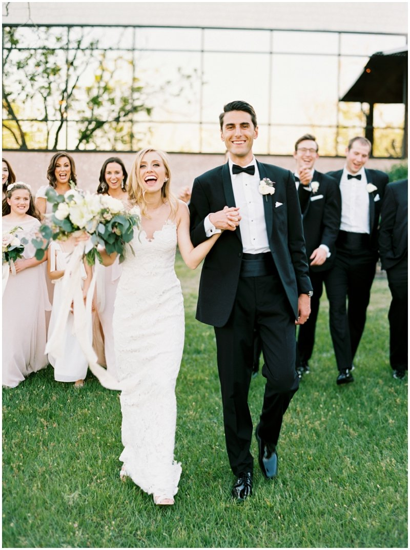 Massive Texas sized wedding party celebrates at black tie wedding  by Top Texas Wedding Photographer Hannah Mayson