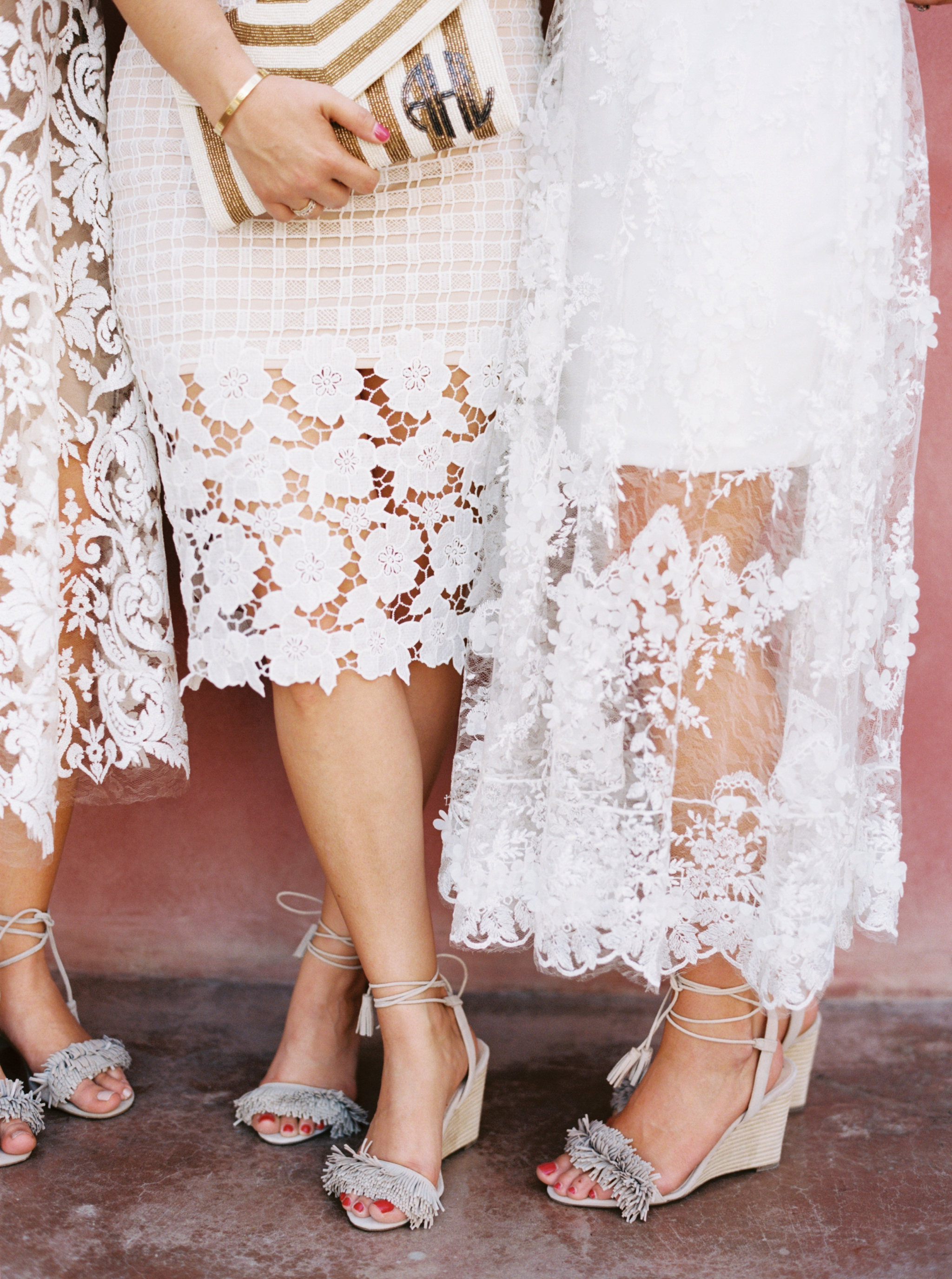 All these bridesmaids wore white, coupled with fringed shoes and clutches designed by the bride  by Top Texas Wedding Photographer Hannah Mayson