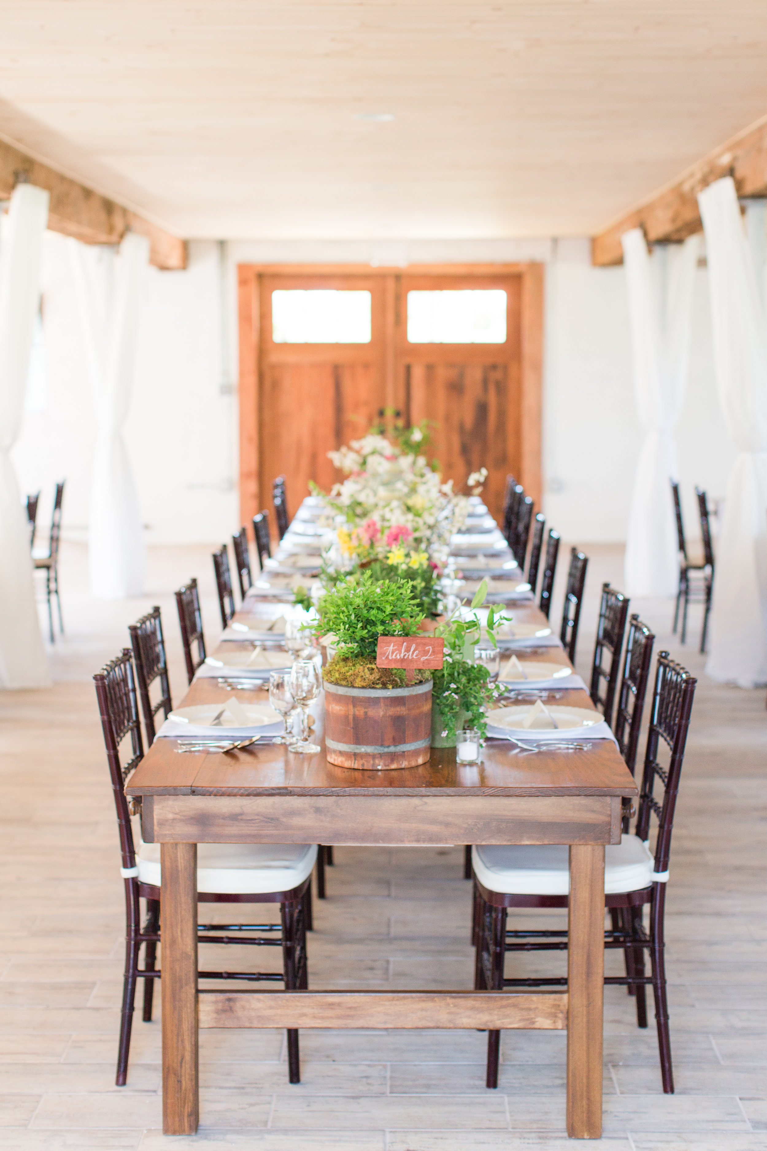I love designing long tables! The inspiration for this table came from an English potting shed and featured a collection of potted plants, cut flowers, boxwood and vintage books on gardening from my library.