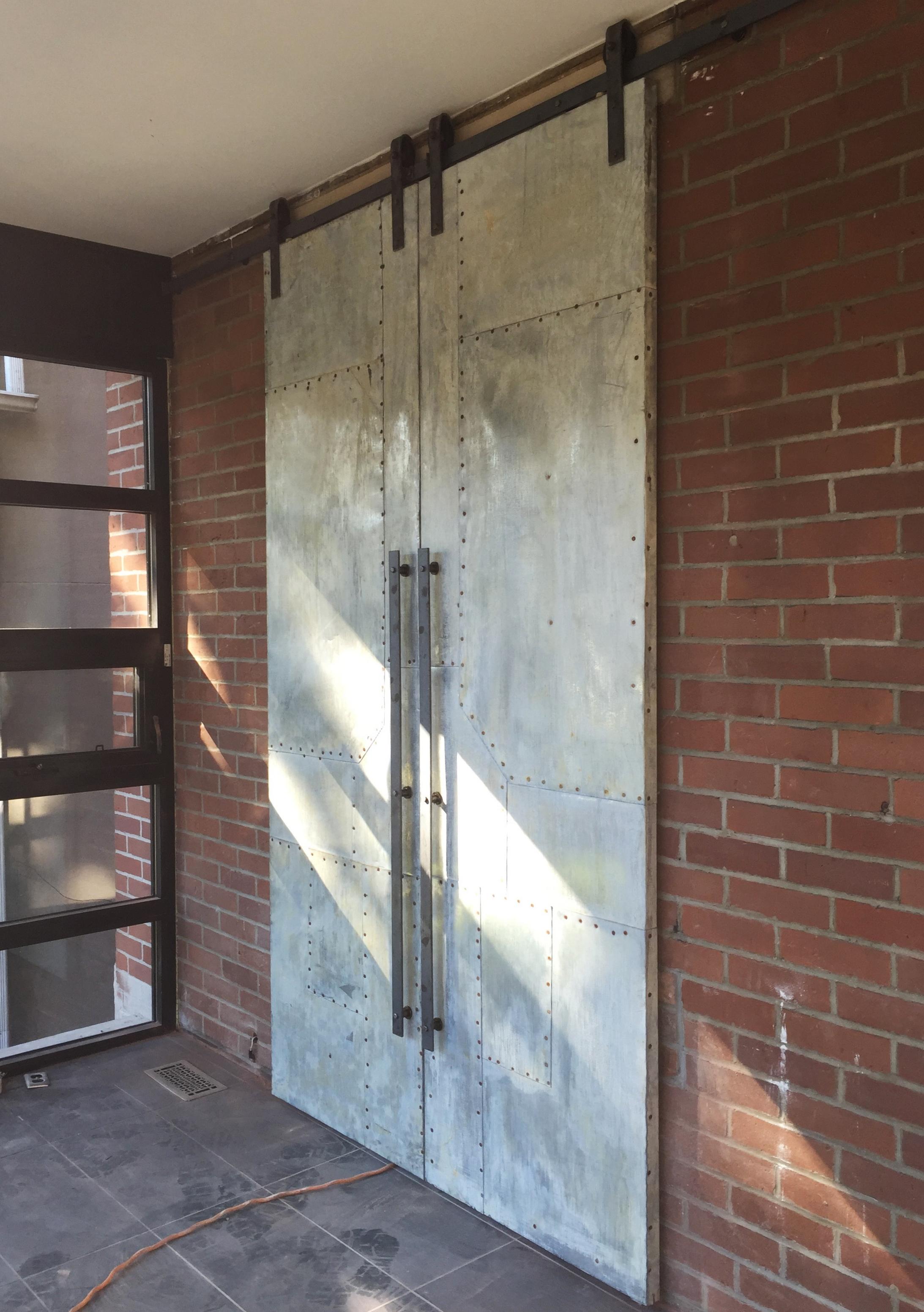 Scrap metal door