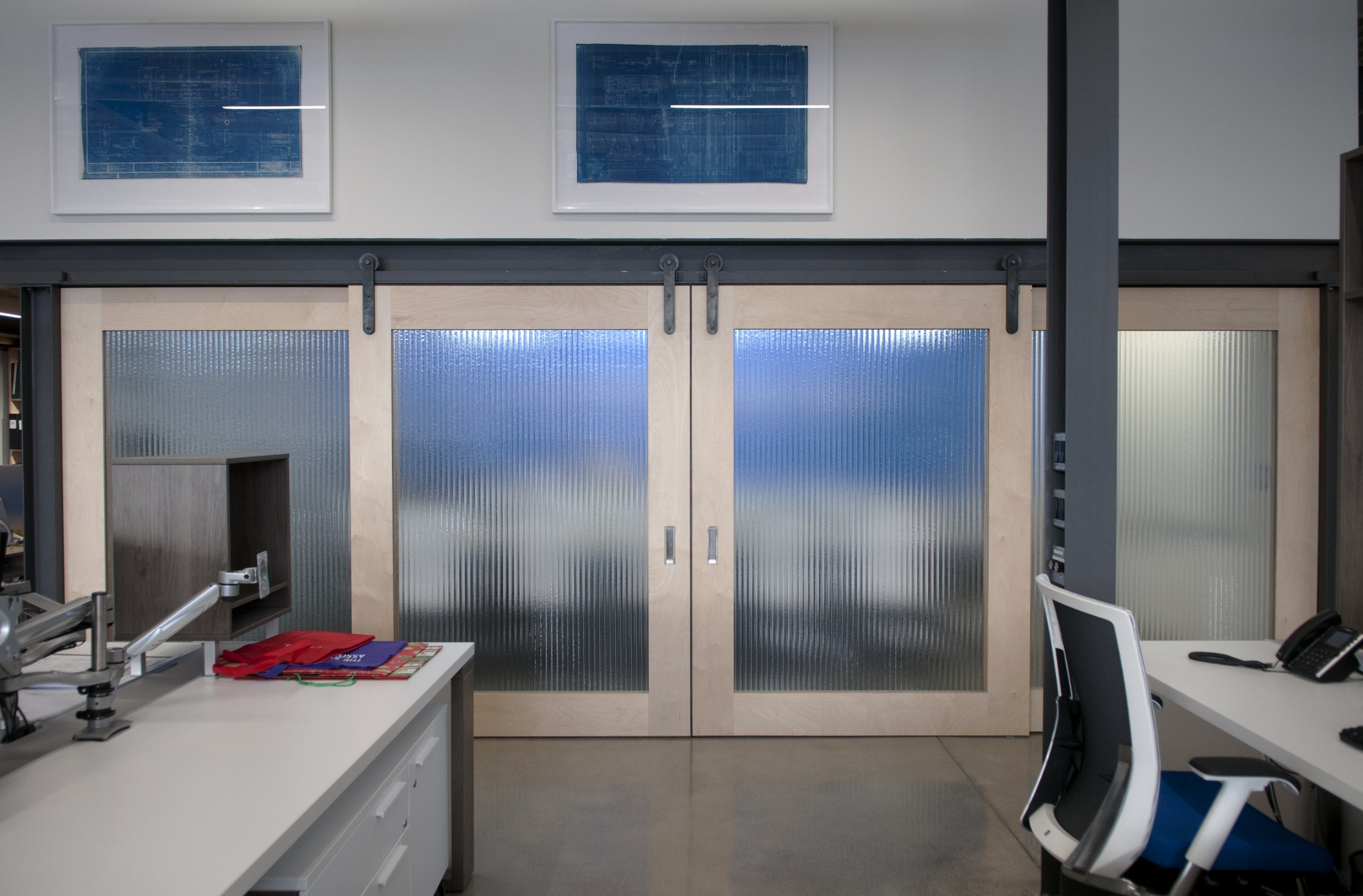 A more frontal view of the board room with the four doors. These doors slide on the existing I-beam!