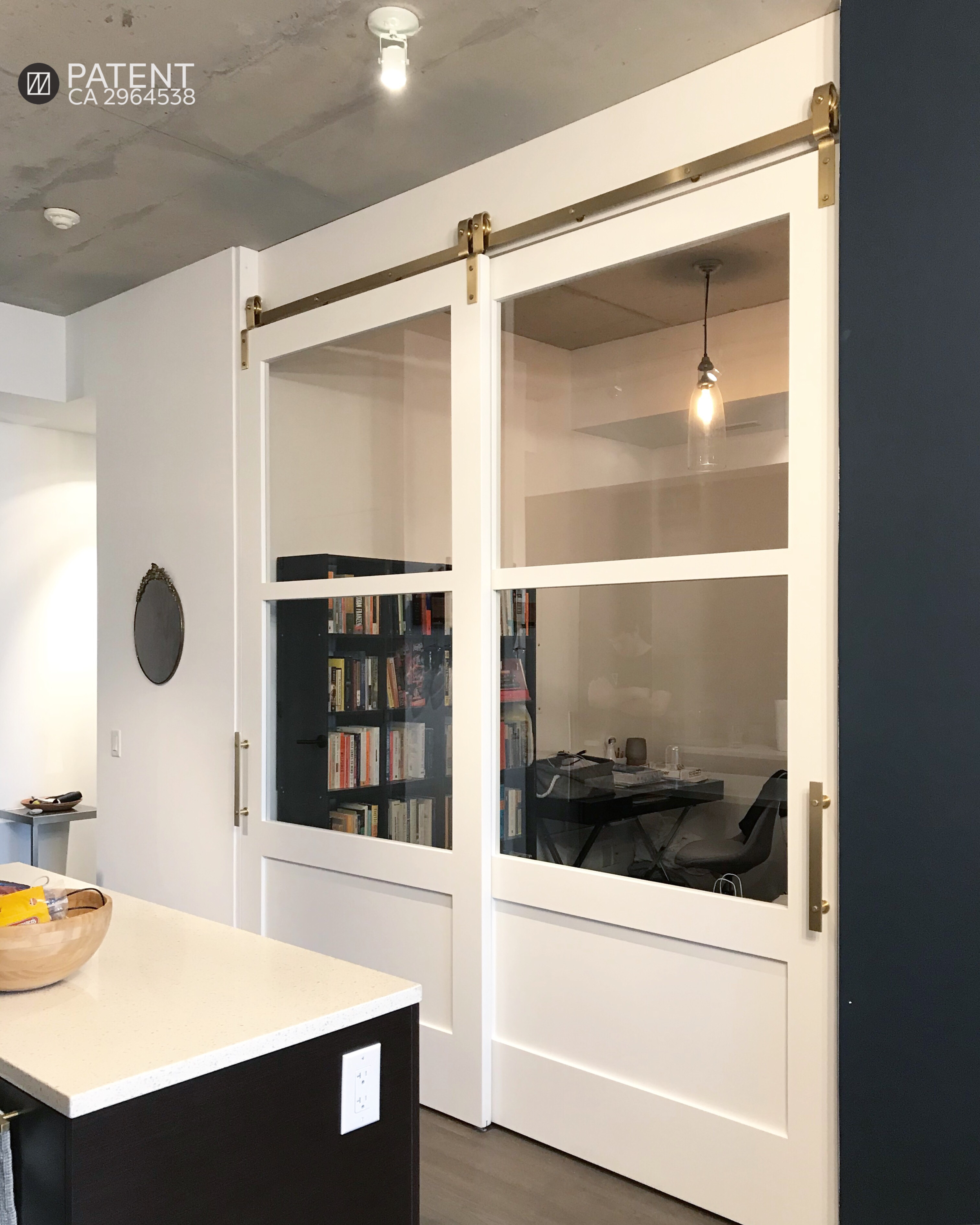 Our single bypass sliding doors with glass inserts convert a den into a home office. Due to their large size, they also serve as a wall.