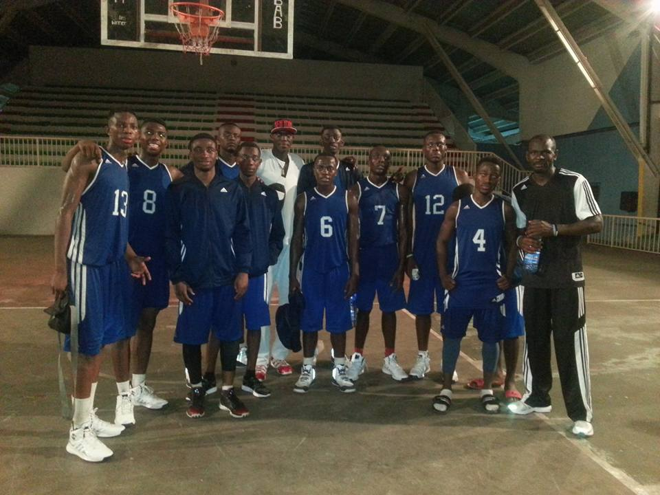 PJB players with the rest of their national team teammates after their qualifying victory. Patrick Mwamba (No. 13), Lucien Mwamba (No. 8), Jospin Basima (No. 5, wearing jacket), Philipe Kasereka (No. 6), Michee Mianga (No. 12), Jerry Kabantu (No. 4) and Coach Kipere Mulolwa (far right).