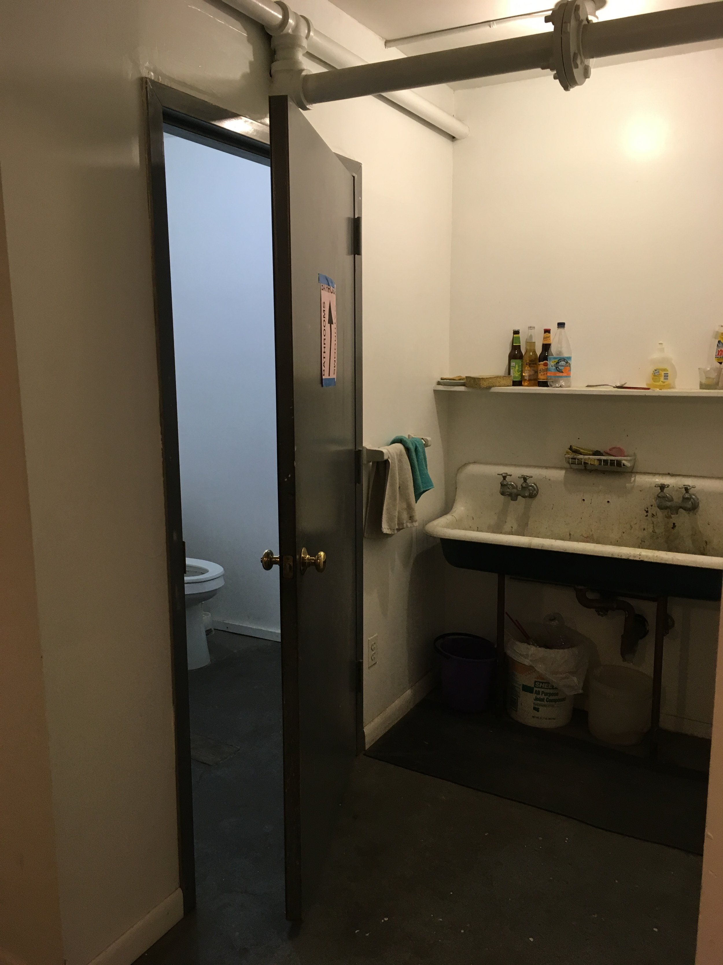 Sink and bathroom across from our studio