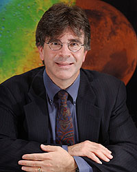 Dr. Jim Garvin | NASA Scientist - Jim Garvin was born in a blizzard in Poughkeepsie (New York) and educated at Brown and Stanford Universities. He received his Ph.D. in Geological Sciences from Brown University in 1984 where his dissertation emphasized the geologic exploration of the surfaces of Mars and Venus. For the past 34 years he has served NASA as a scientist in various capacities, including his present role as the Chief Scientist of NASA's flagship science center (Goddard Space Flight Center), as well as a member of the MSL/Curiosity Mars rover and Mars InSight Lander Science Teams. He is also serving NASA Headquarters as a special science advisor for Mars to the Mars Program Director. In his overall present capacity, he is helping to plan NASA's continuing Mars exploration program, catalyze new missions to Mars, Venus, and Earth, orchestrate innovative scientific research, and to help integrate human and robotic exploration.