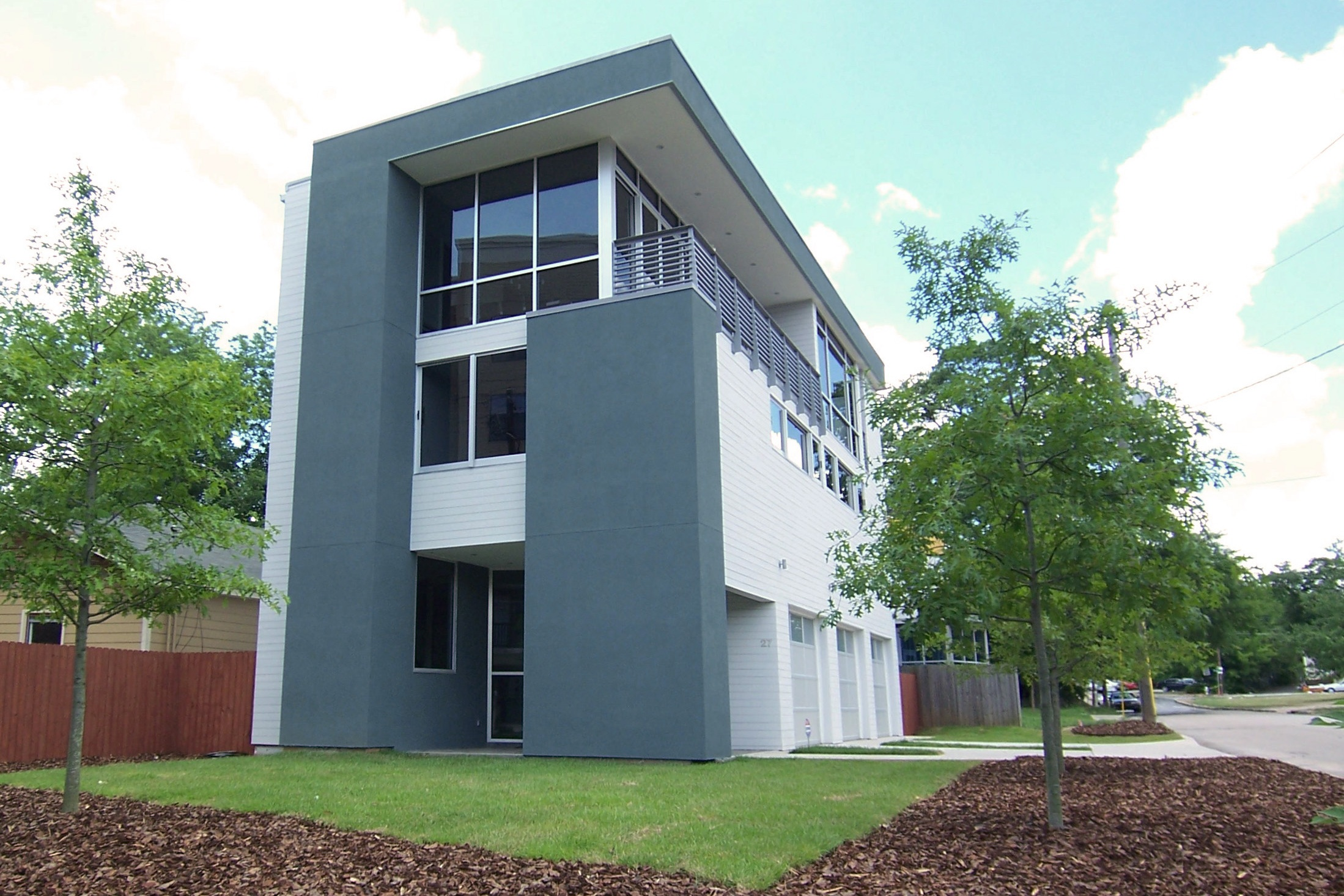New home near the MLK center and Auburn district in Atlanta. The floor plan is reversed with the main living floor on top to maximize views, the bedrooms are on the second level and the street level contains a three car garage and foyer. A dumbwaiter was installed to carry groceries, etc up to the third floor from the garage.