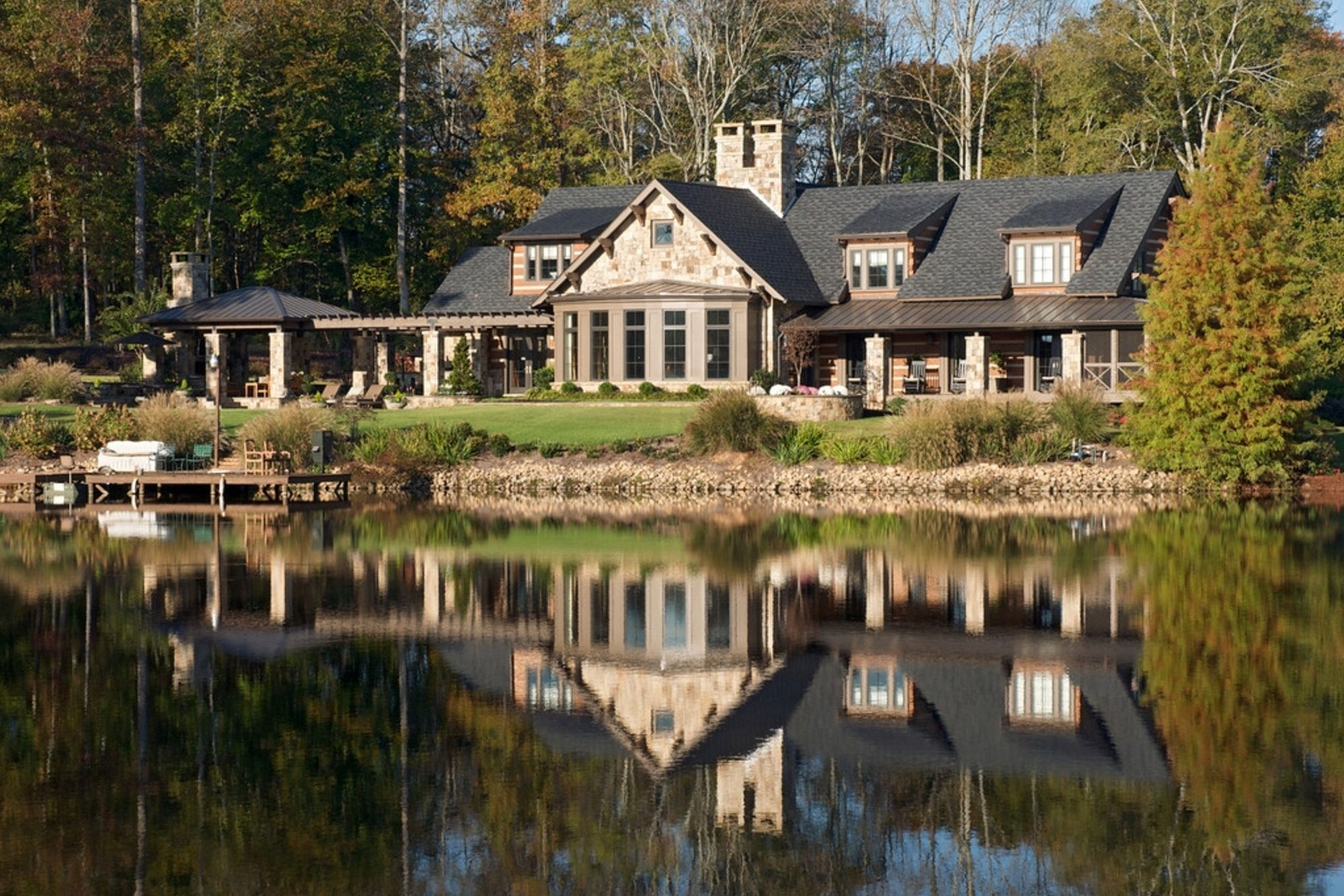 Renovation and addition to an existing family home near Lake Oconee, Georgia. The existing home was a log cabin and the new design responds to this through use of materials and massing. Project completed while employed as a project manager for Kemp Hall Studio which was the Architect of record.