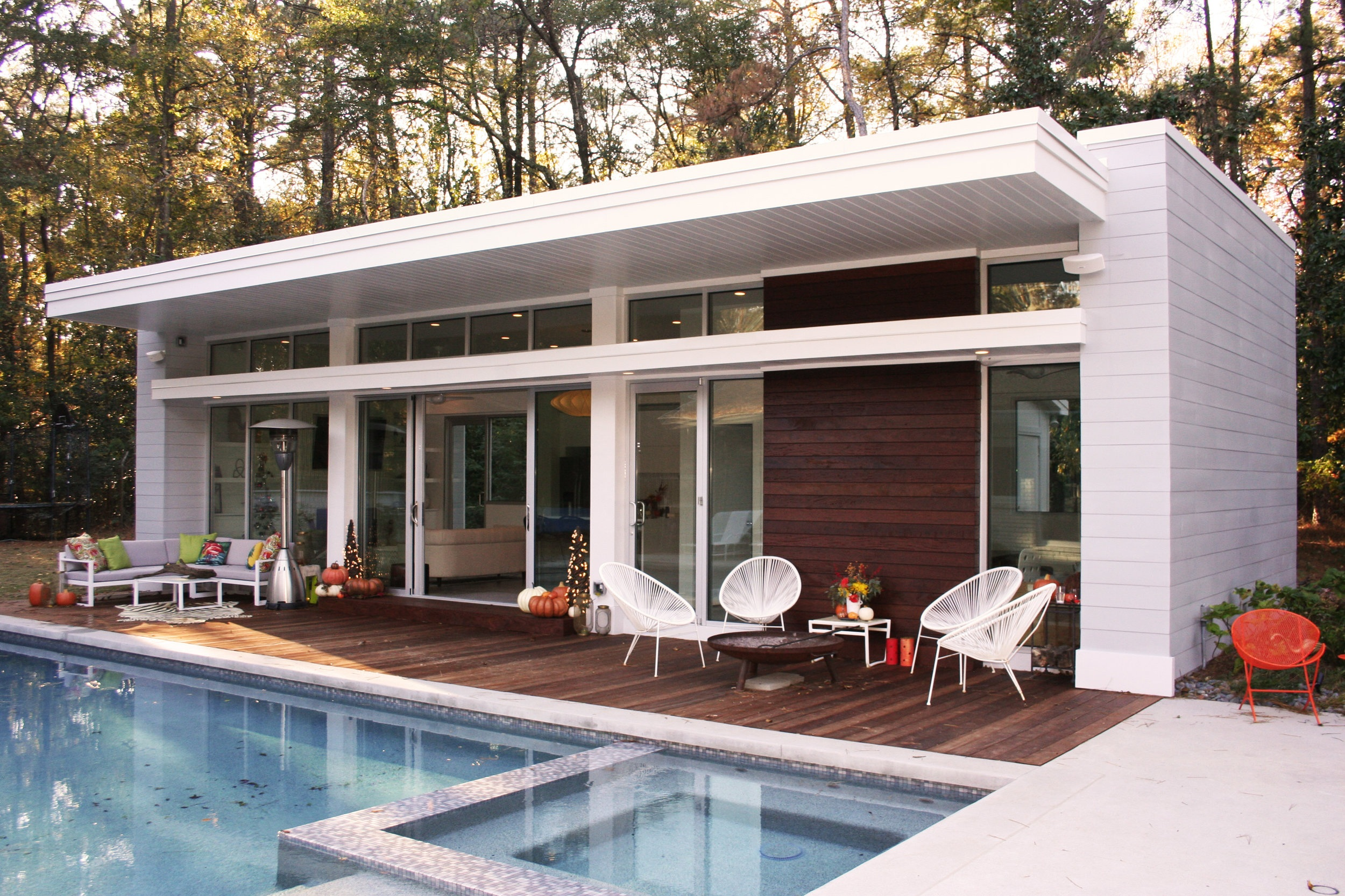 New pool house and renovation design of a 1950s midcentury modern ranch house located in the Buckhead area of Atlanta.
