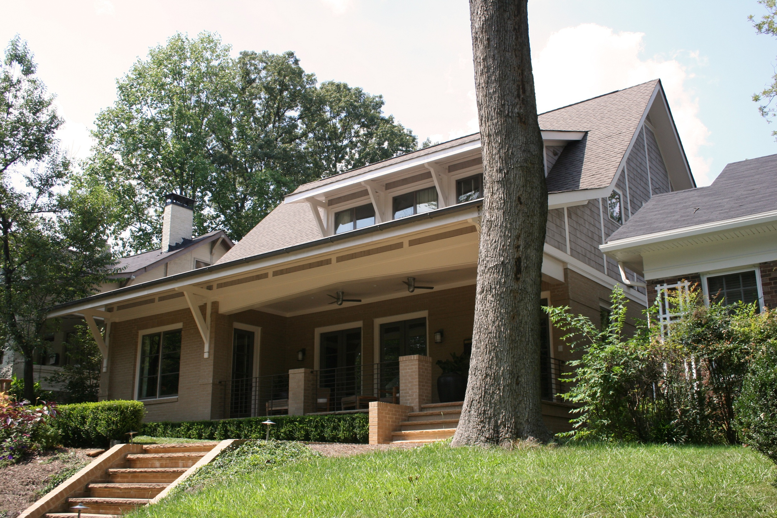 New home in the Virginia Highlands neighborhood of Atlanta. The home is designed to fit into it's surroundings through it's careful massing and detailing. It's spare modern details on the exterior elude to it's soft modern interior featuring all natural materials applied in a contemporary manner. Featured on HGTV in 2007 and Atlanta Homes and Lifestyles. Interior Design by Joel Kelly Design Studio. Landscape Architecture by David Bennett. Project completed while employed as a Project Manager with Joel Kelly Design.