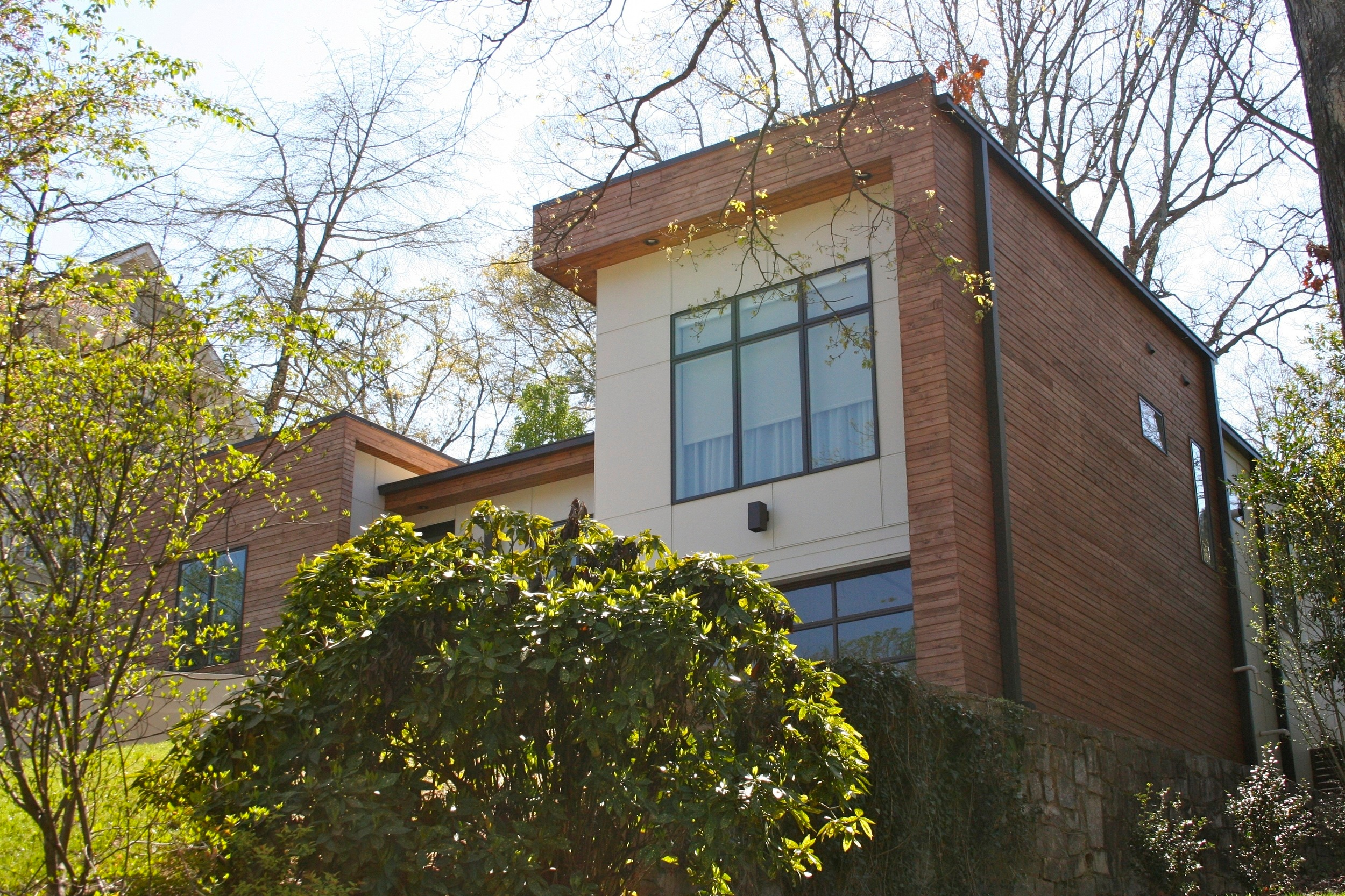 Complete renovation of 1950s 2 bedroom 1 bath home into a modern 3 bedroom and 2 1/2 bath home. The existing walls and foundation remained but the roof and exterior materials were completely reworked. Located in the Morningside neighborhood of Midtown Atlanta.