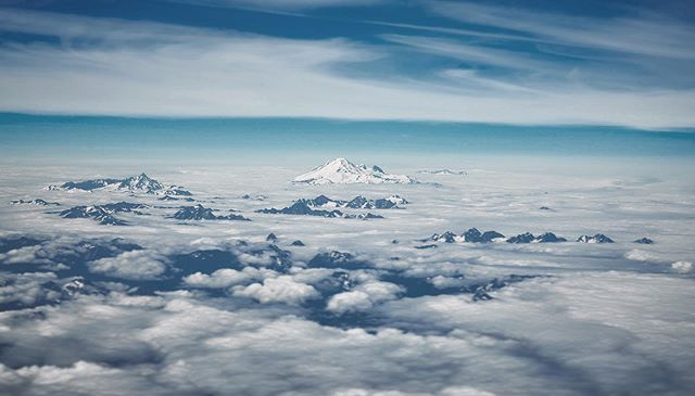 About 40 minutes east of Vancouver, the clouds covered all the mountains I had hoped to see, except for one. It might be Mt. Robie Reid, but I'm not sure?? #windowseat #aerialphotography #mountains #explorecanada #summit #britishcolumbia #mountainrange #nikond850
