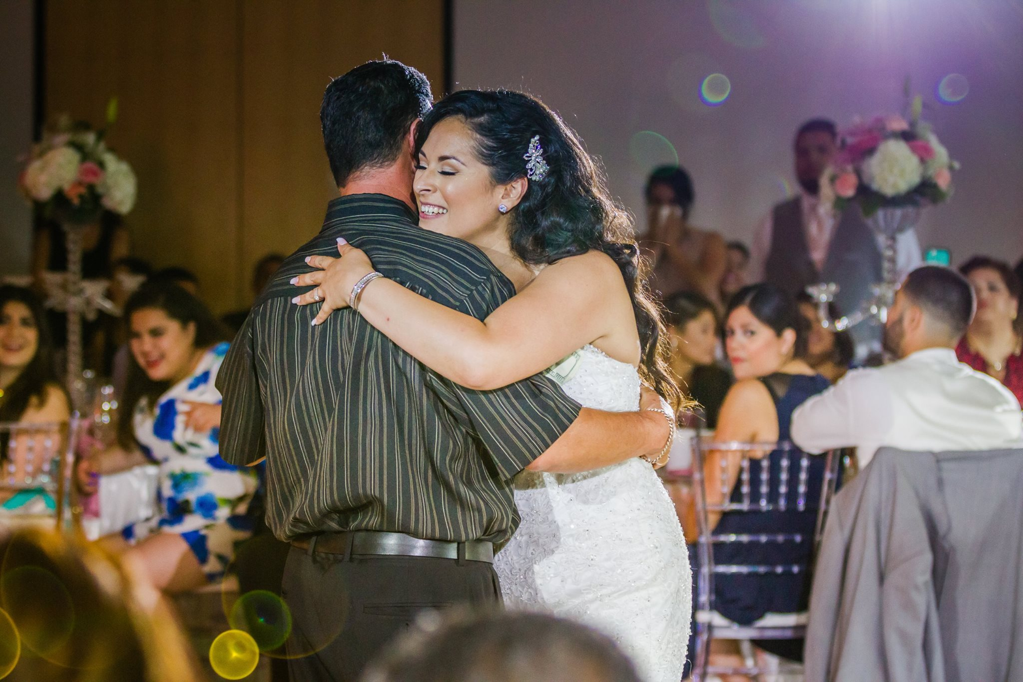Jaquie and her father share their first dance. Reception at Arrillaga Family Recreation Center in Menlo Park.