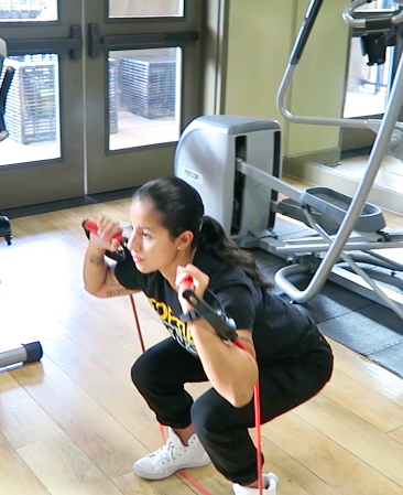 In home personal trainer Squat to Press