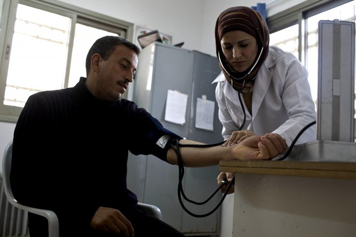 nurse-checking-patients-in-a-community-clinic-west-bank-gaza-improving-community-health-725x483