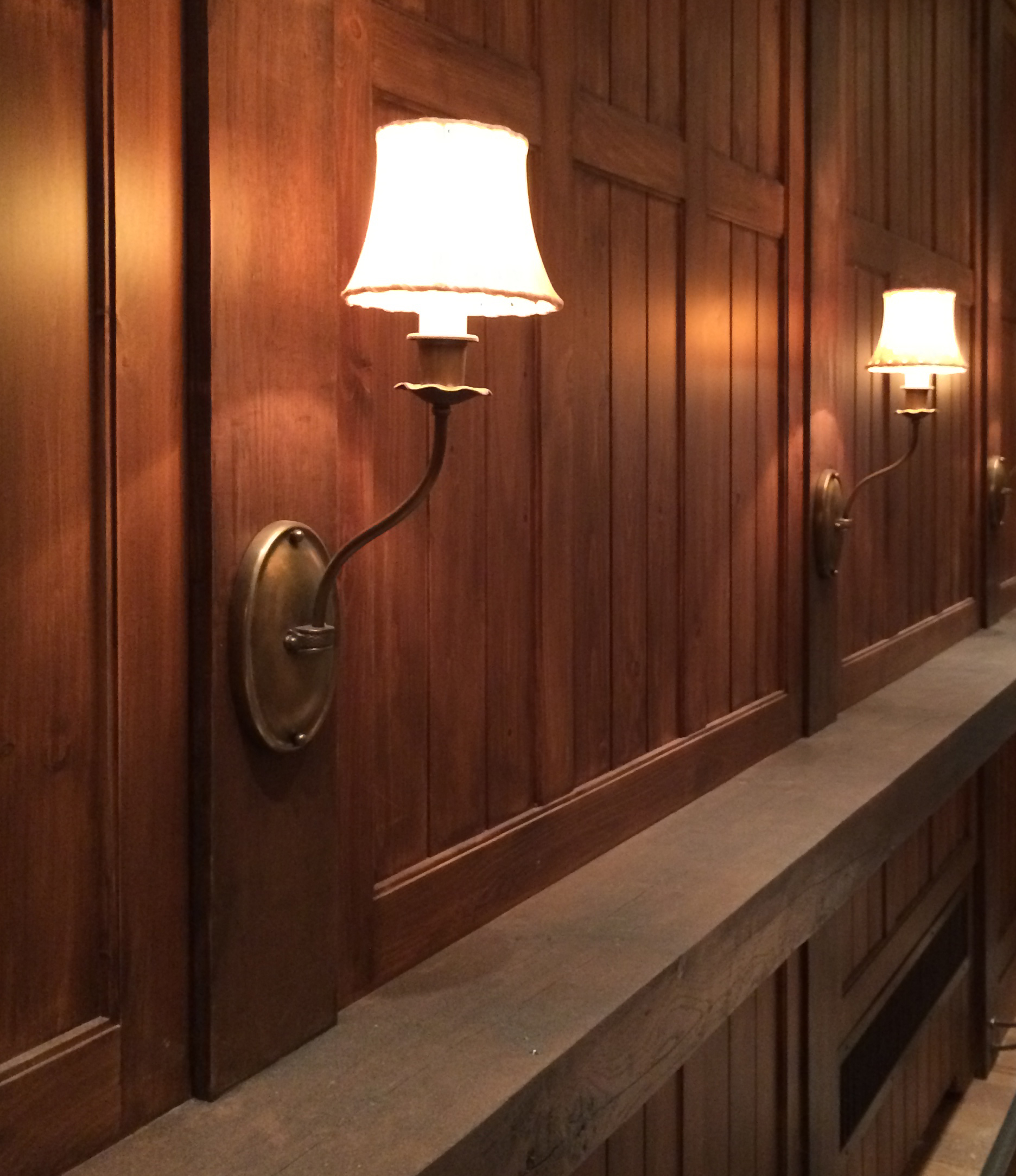 New Rough-Hewn Timber Drink Ledge with Wall Paneling and Custom Wall Sconces