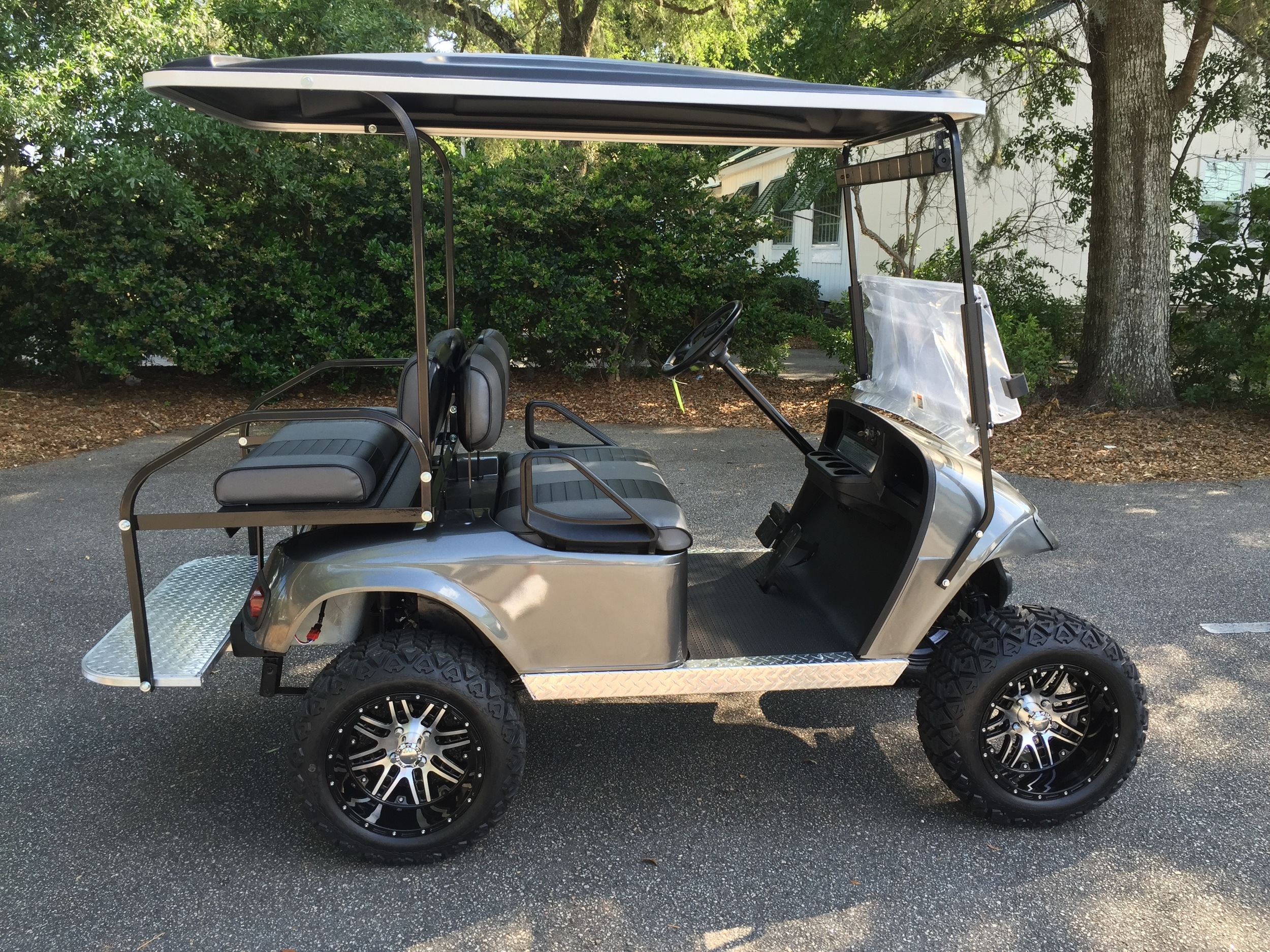 2015 Charcoal EZGO Lifted Cart ——- In Stock  Charcoal/black seats, black extended top, new 2019 batteries 48vt (6-8), LED lights, Backlash (23x10x14) tires, mirror & flip windshield