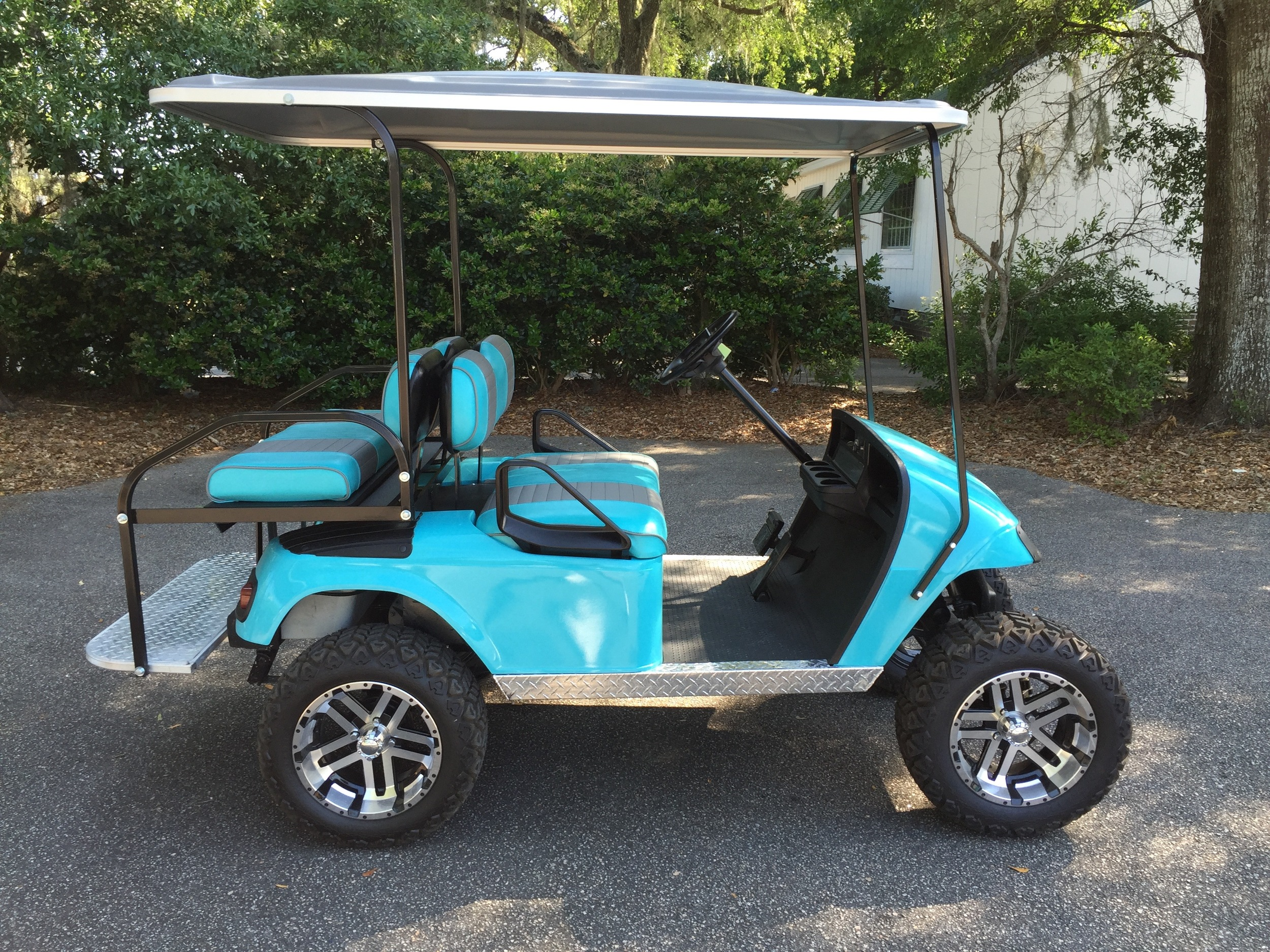 Aqua EZGO Lifted Cart  Aqua/smoke seats, gray extended top, new batteries, LED lights, Backlash (23x10x14) tires, high speed code, mirror, flip windshield and state of charge meter