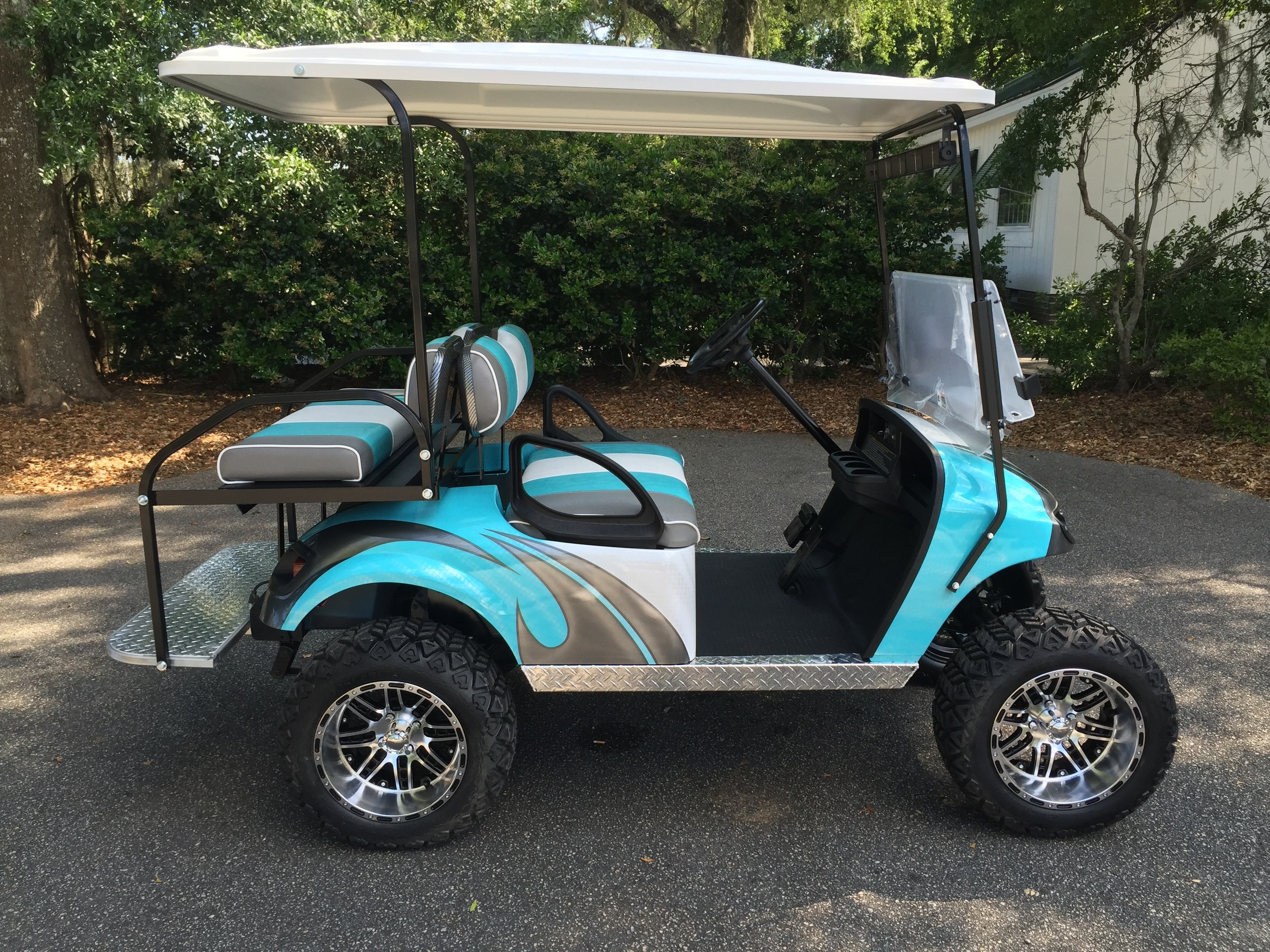 Aqua Swirl EZGO Lifted Cart  Aqua/smoke/white seats, white extended top, new batteries, high speed code, LED lights, Backlash (23x10x14) tires, mirror, flip windshield, and state of charge meter