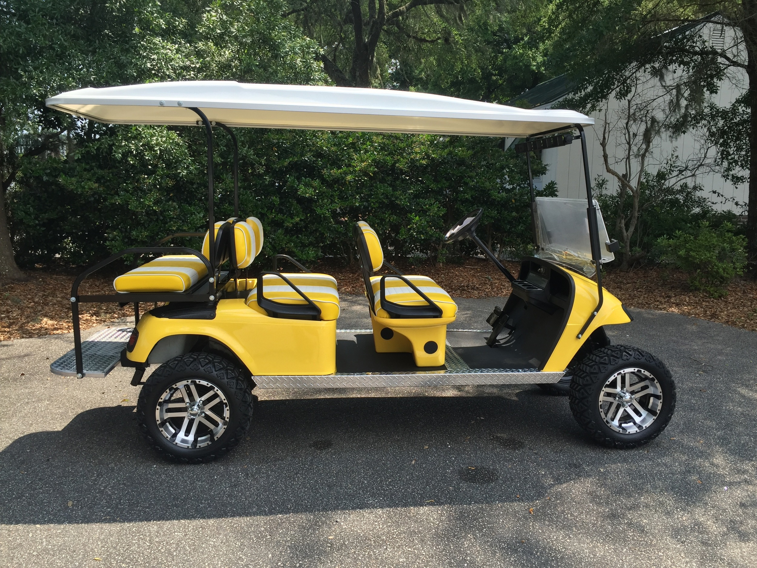 Yellow EZGO Lifted Trolley  Yellow/white seats, white top, new 2018 batteries, high speed code, LED lights, Backlash (23x10x14) tires, state of charge meter, mirror, and flip windshield