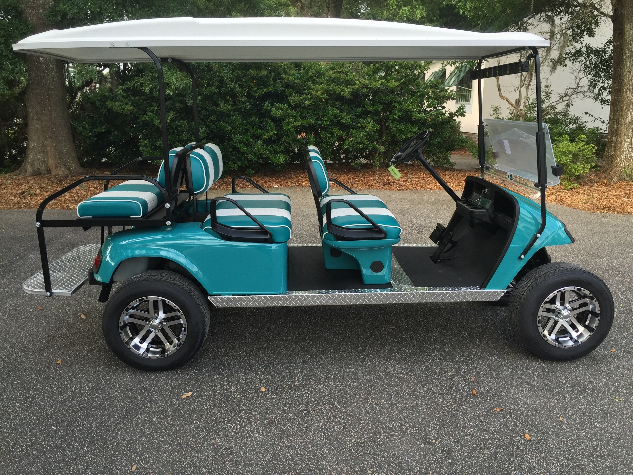 Teal EZGO Lifted Trolley  Teal/white seats, white top, new 2018 (6-8vt) batteries, high speed code, LED lights, Backlash (23x10x14) tires, state of charge meter, mirror, and flip windshield