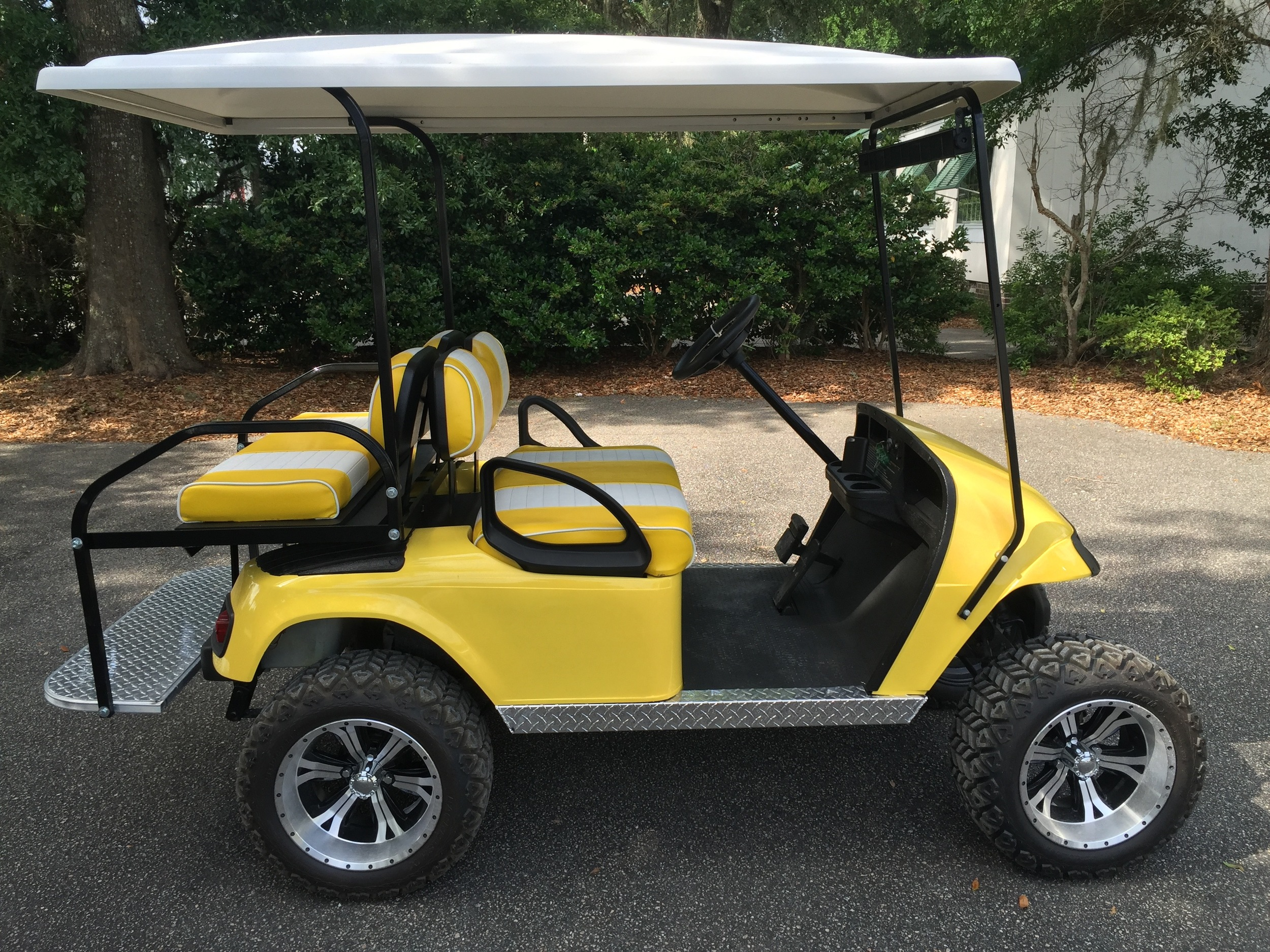 Yellow EZGO Lifted Cart  Yellow/white seats, white extended top, new (2017) batteries, high speed code, LED lights, Backlash (23x10x14) tires, mirror, flip windshield, and state of charge meter