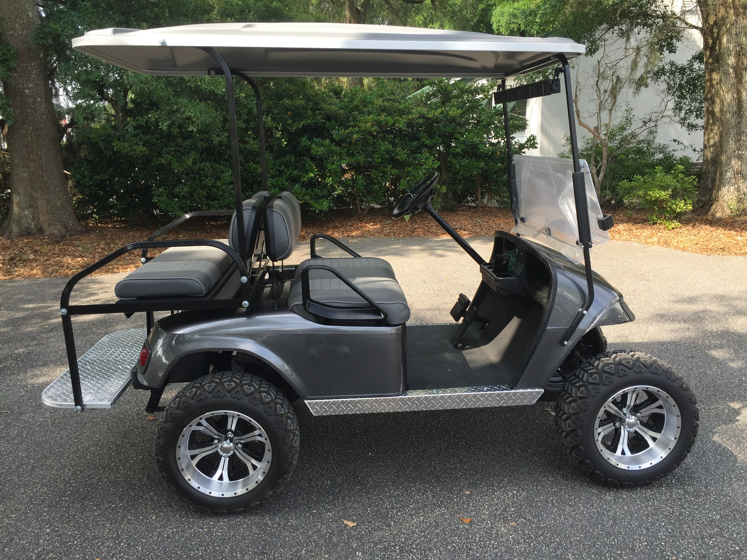 2015 Charcoal EZGO Lifted Cart ———In Stock  Charcoal/smoke seats, gray extended top, new 2019 batteries 48vt (6-8), high speed code, state of charge meter, LED lights, Backlash (23x10x14) tires, mirror, and flip windshield