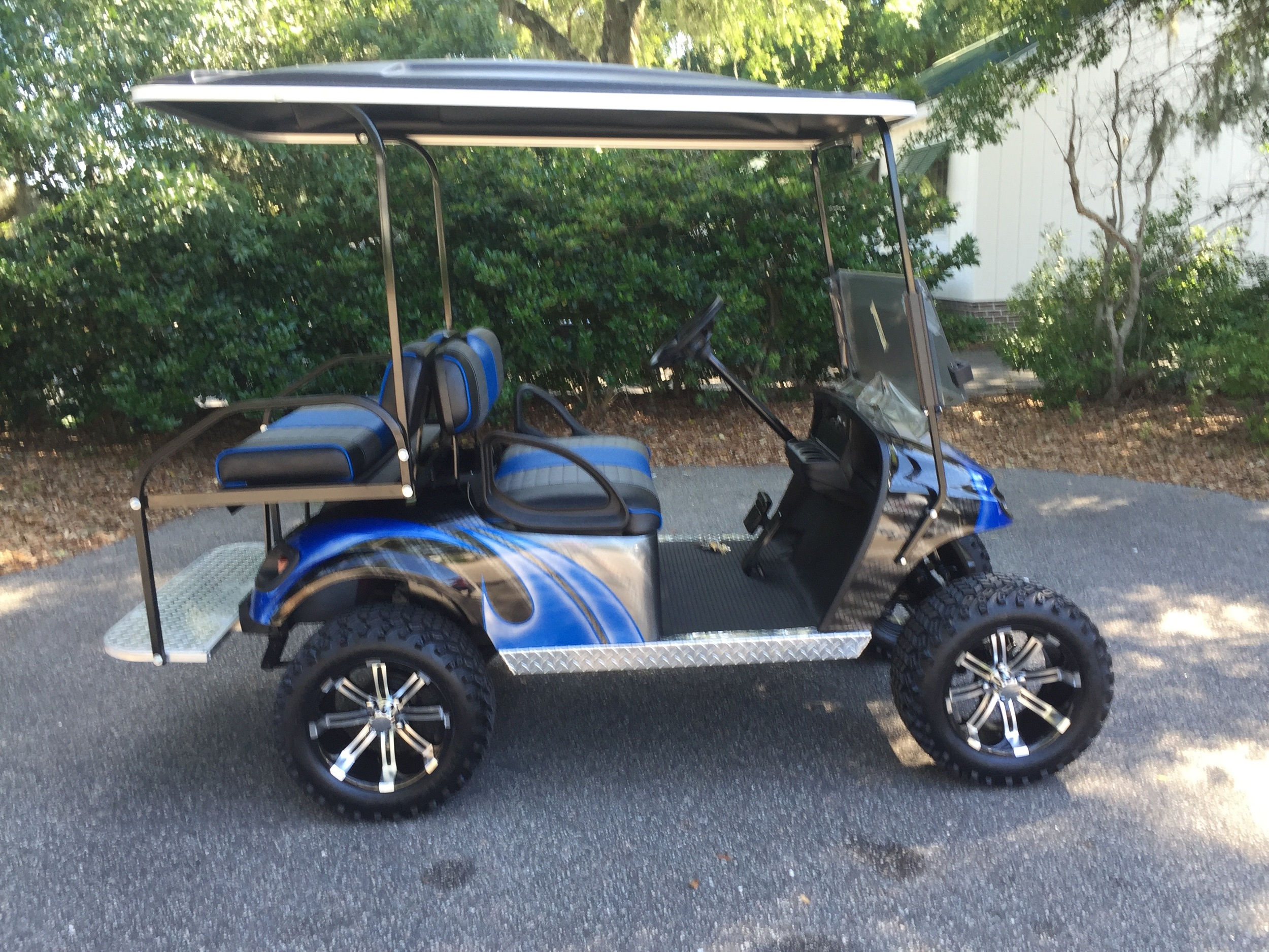 Viper Blue Swirl EZGO Lifted Cart  Viper blue/charcoal/black seats, black extended top, new batteries, high speed code, LED lights, Backlash (23x10x14) tires, mirror, flip windshield, and state of charge meter