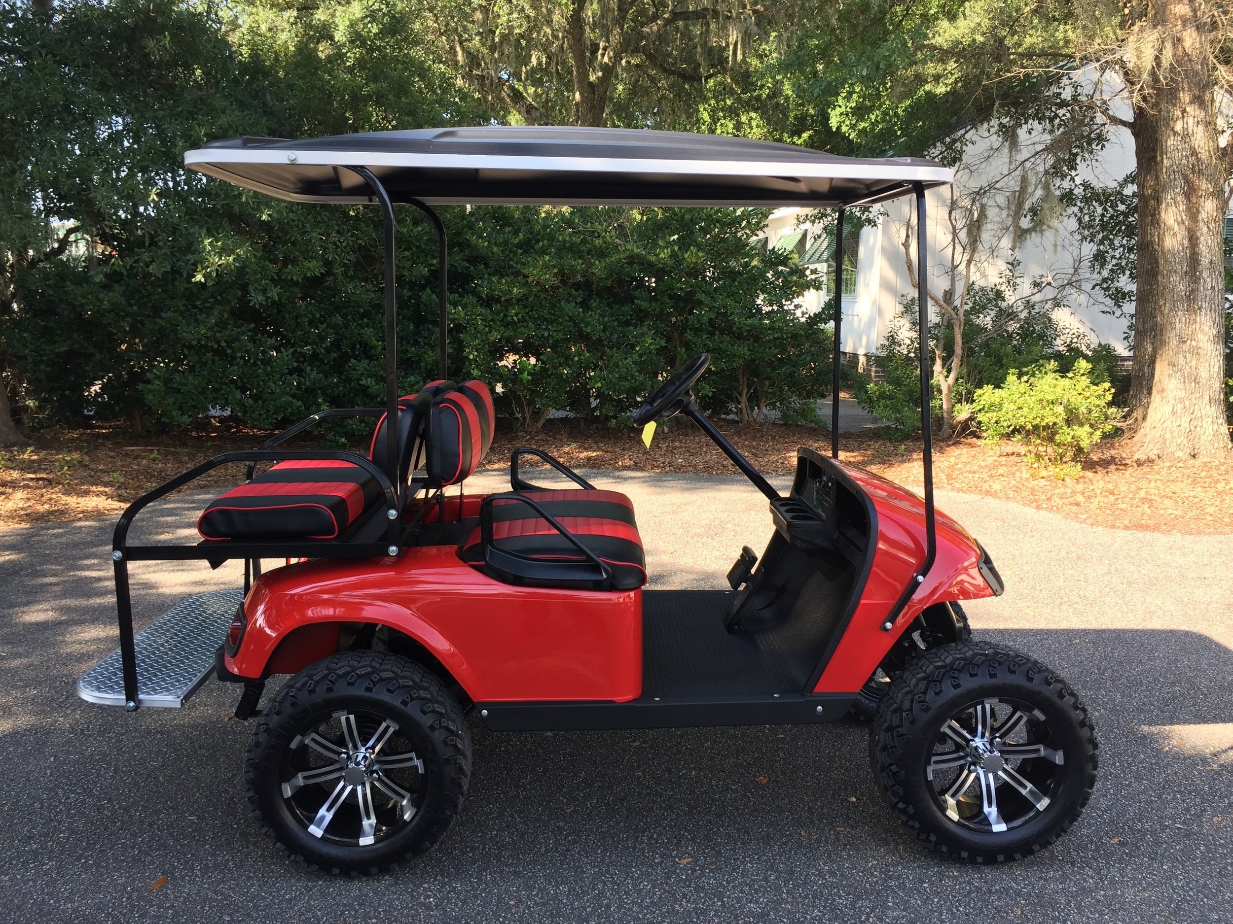 Red EZGO Lifted Cart  Red/black seats, black extended top, new batteries, high speed code, LED lights, and Backlash (23x10x14) tires