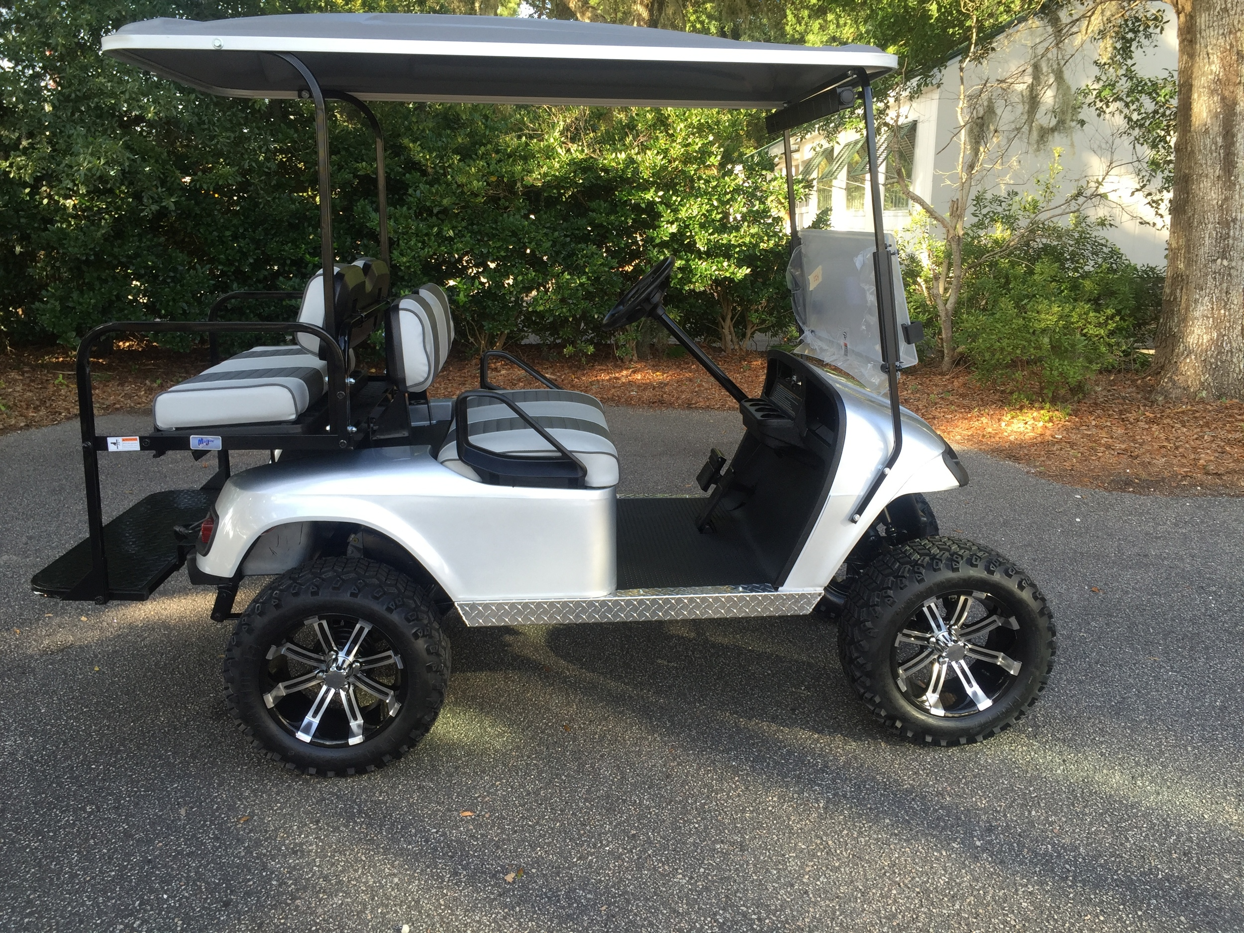 Silver EZGO Lifted Cart  Gray/charcoal seats, gray extended top, new 2018 batteries, high speed code, LED lights, Backlash (23x10x14) tires, mirror, flip windshield, and state of charge meter
