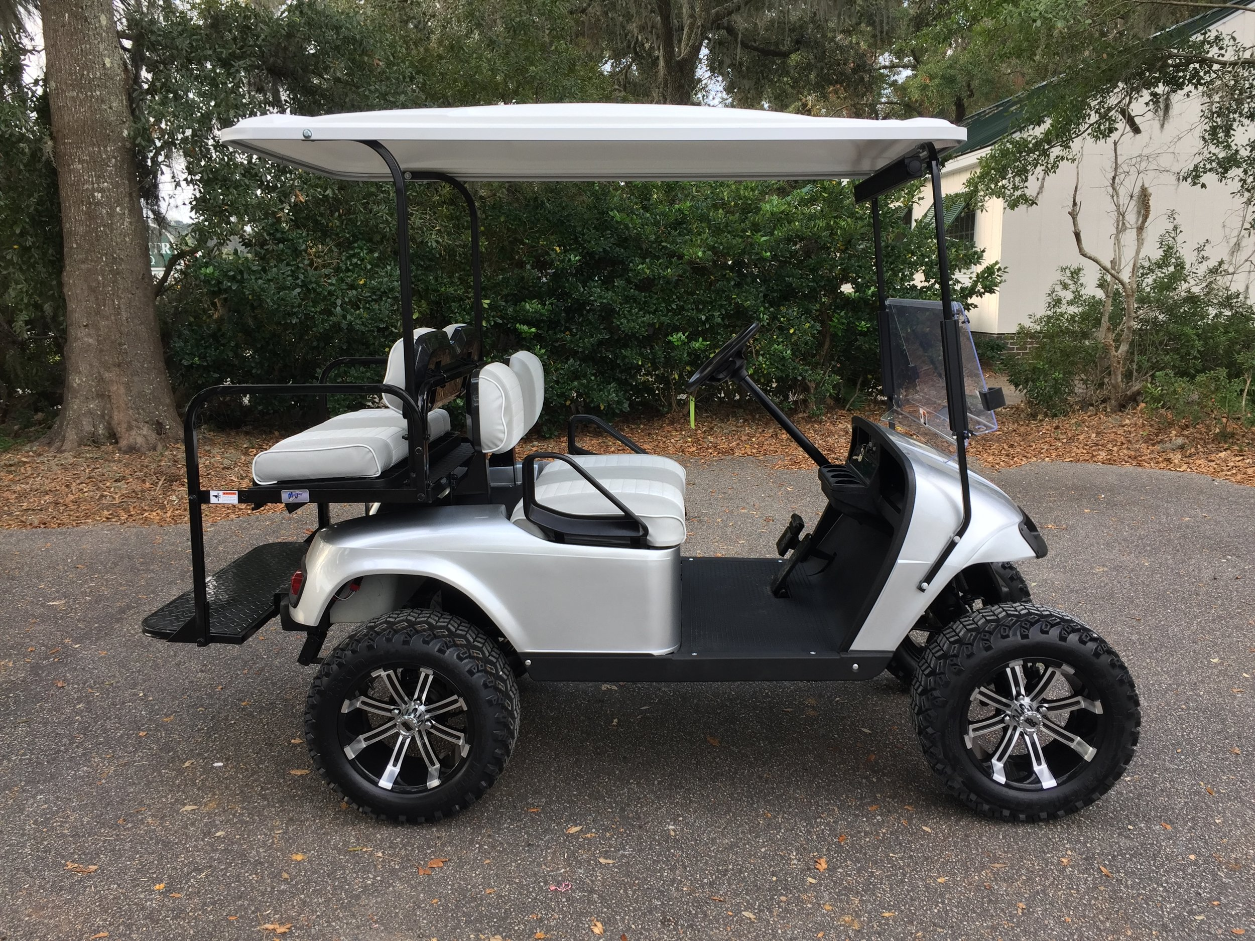 Silver EZGO Lifted Cart  Silver/white seats, white extended top, new batteries, LED lights, Backlash (23x10x14) tires, high speed code, state of charge meter, mirror, and flip windshield