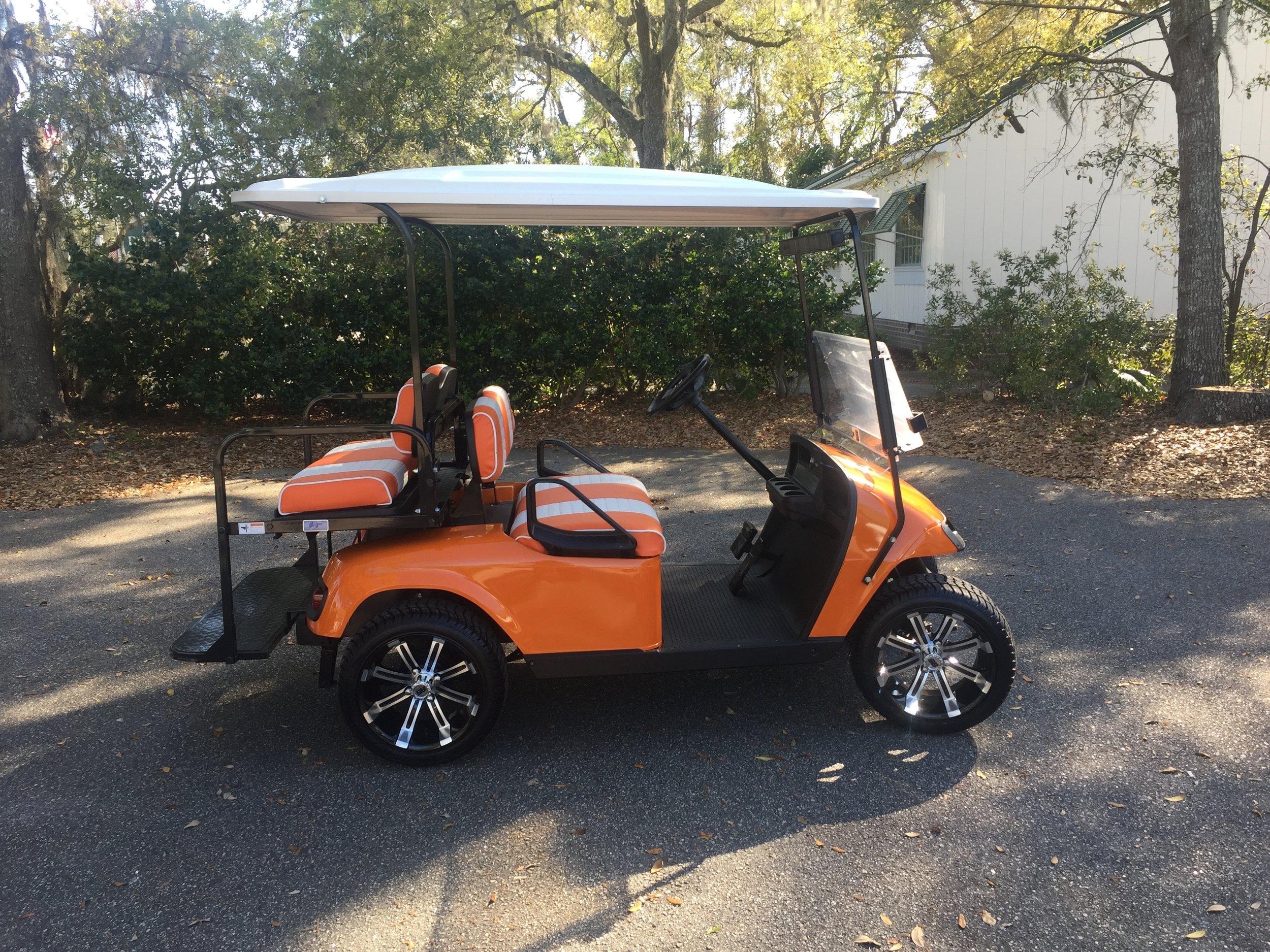 2015 Orange EZGO Cart —————   Orange/white seats, white extended top, new 2019 batteries 48vt (6-8), high speed code, LED lights, Lo Pro tires, mirror & flip windshield