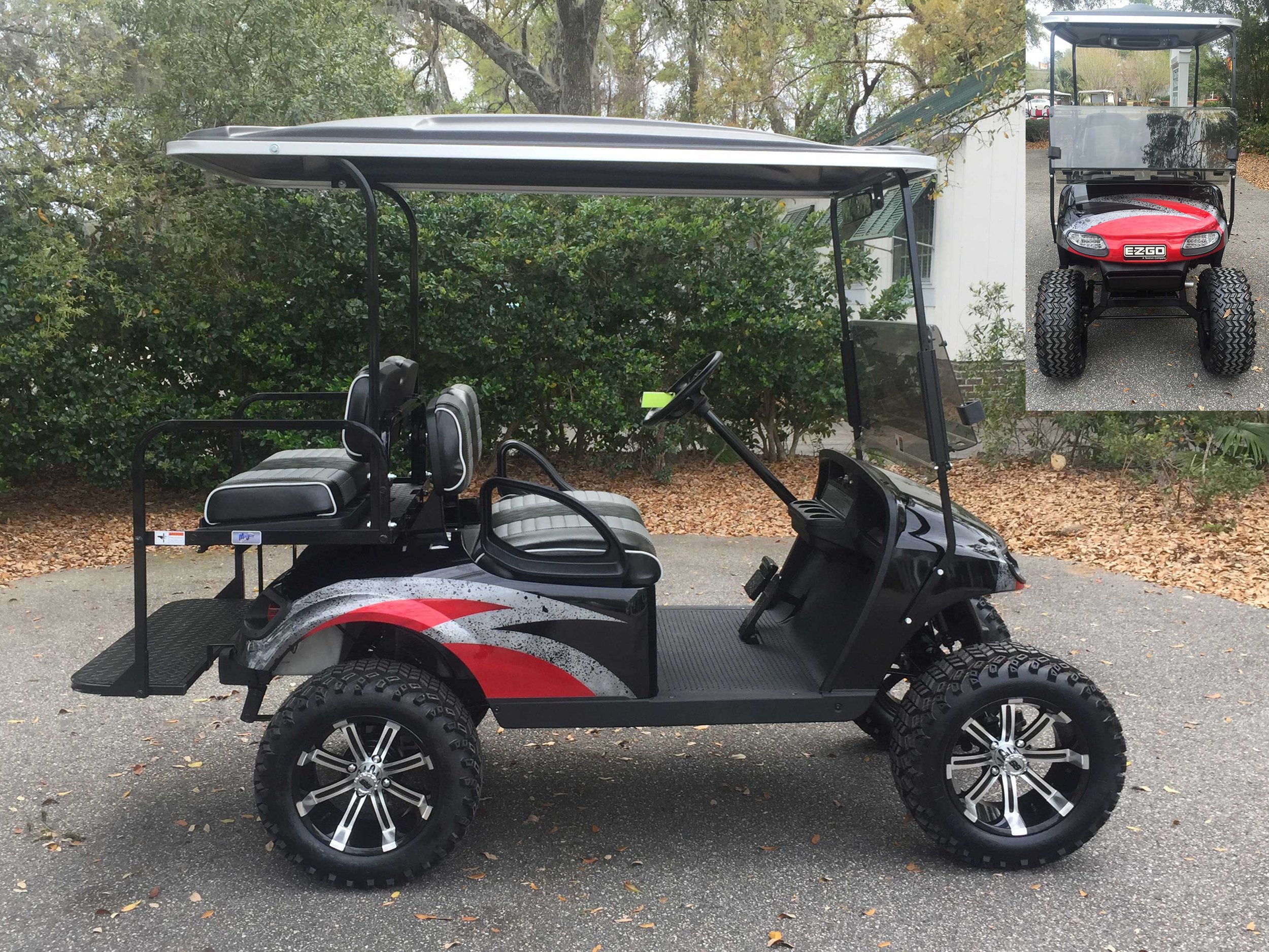 Black Side Swirl EZGO Lifted Cart  Black/charcoal seats, black extended top, new batteries, high speed code, LED lights, Backlash (23x10x14) tires, mirror, flip windshield, and state of charge meter