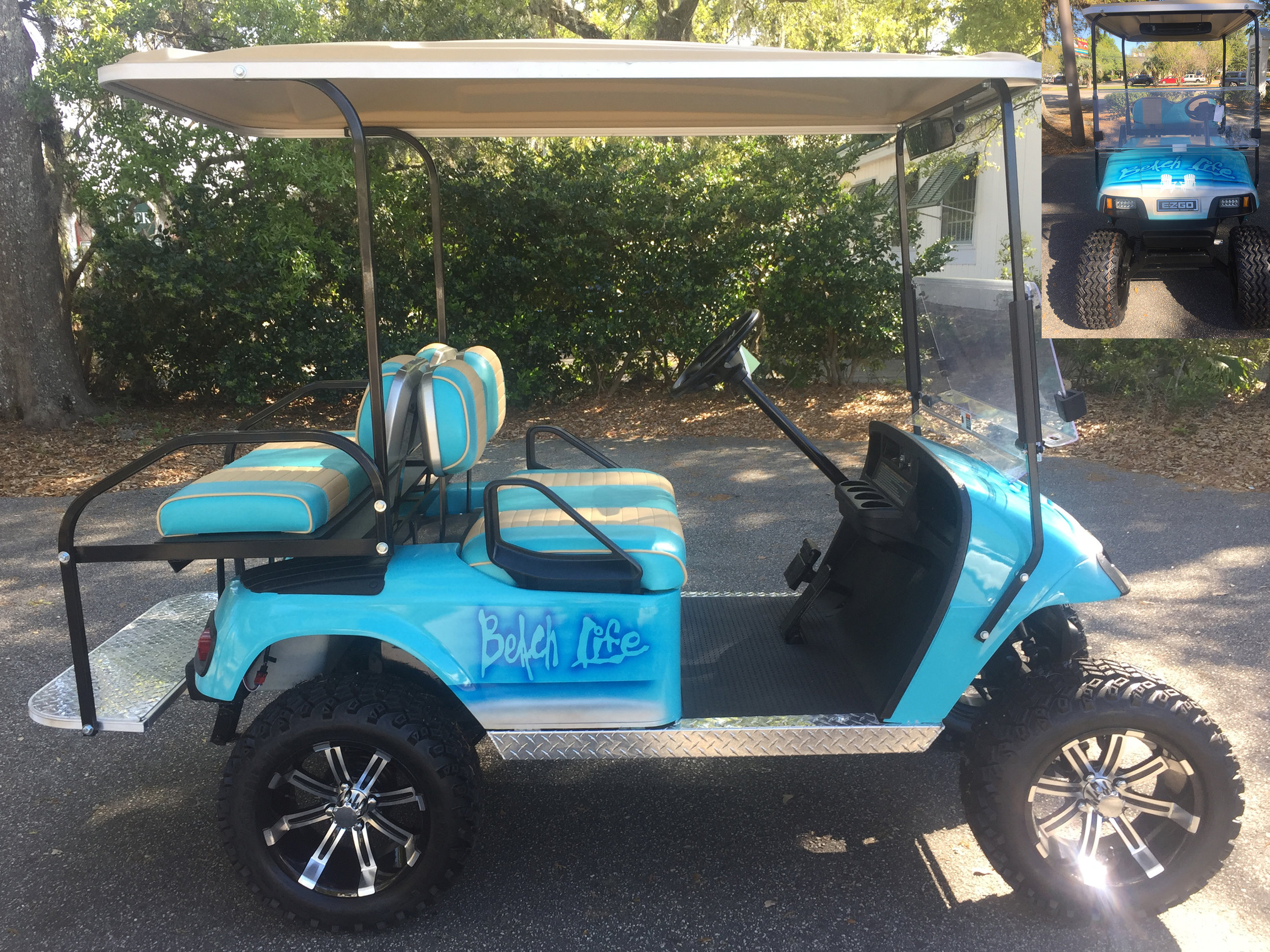 Aqua Beach Life EZGO Lifted Cart  Aqua/tan seats, tan extended top, new batteries, high speed code, LED lights, Backlash (23x10x14) tires, mirror, flip windshield, and state of charge meter