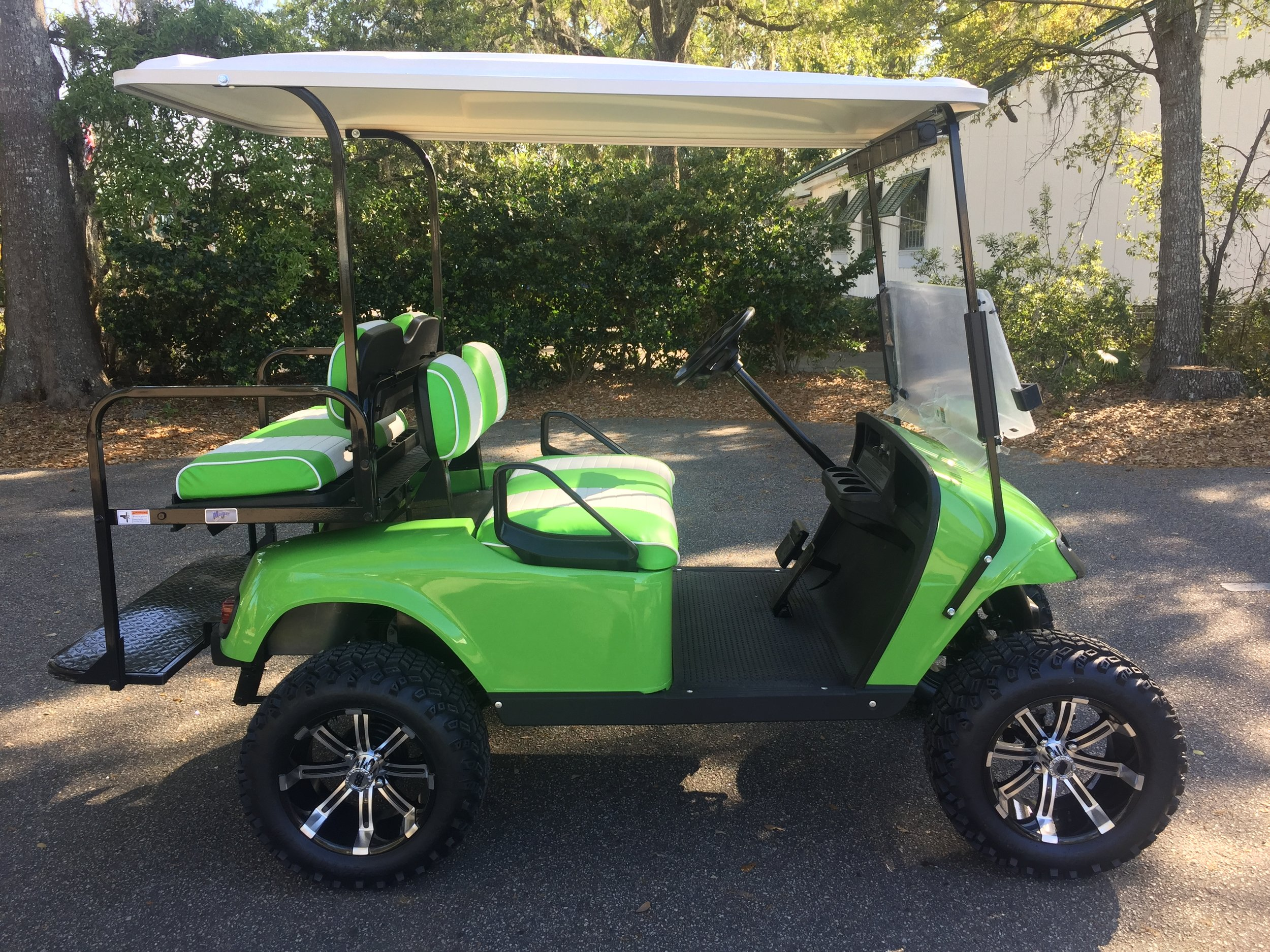Lime Green EZGO Lifted Cart  Lime green/white seats, white extended top, new batteries, high speed code, LED lights, Backlash (23x10x14) tires, mirror, flip windshield, and state of charge meter