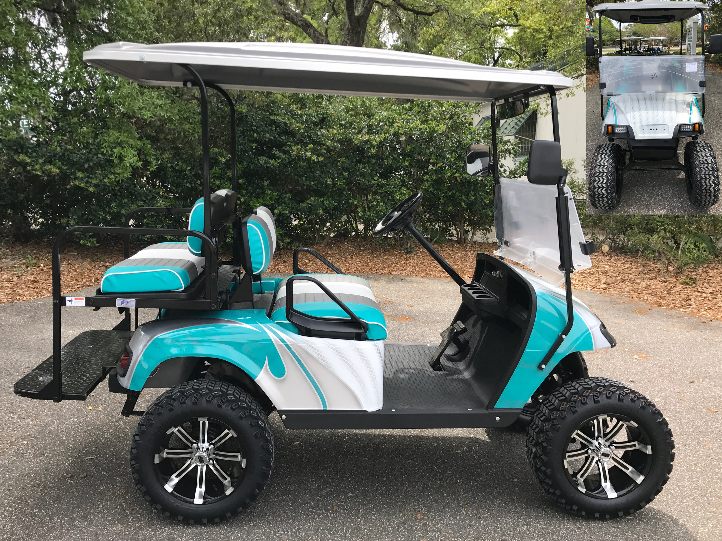 Emerald Swirl EZGO Lifted Cart  Emerald/smoke/white seats, gray extended top, new batteries, high speed code, LED lights, Backlash (23x10x14) tires, state of charge meter, rear view mirror, side mirrors, and flip windshield