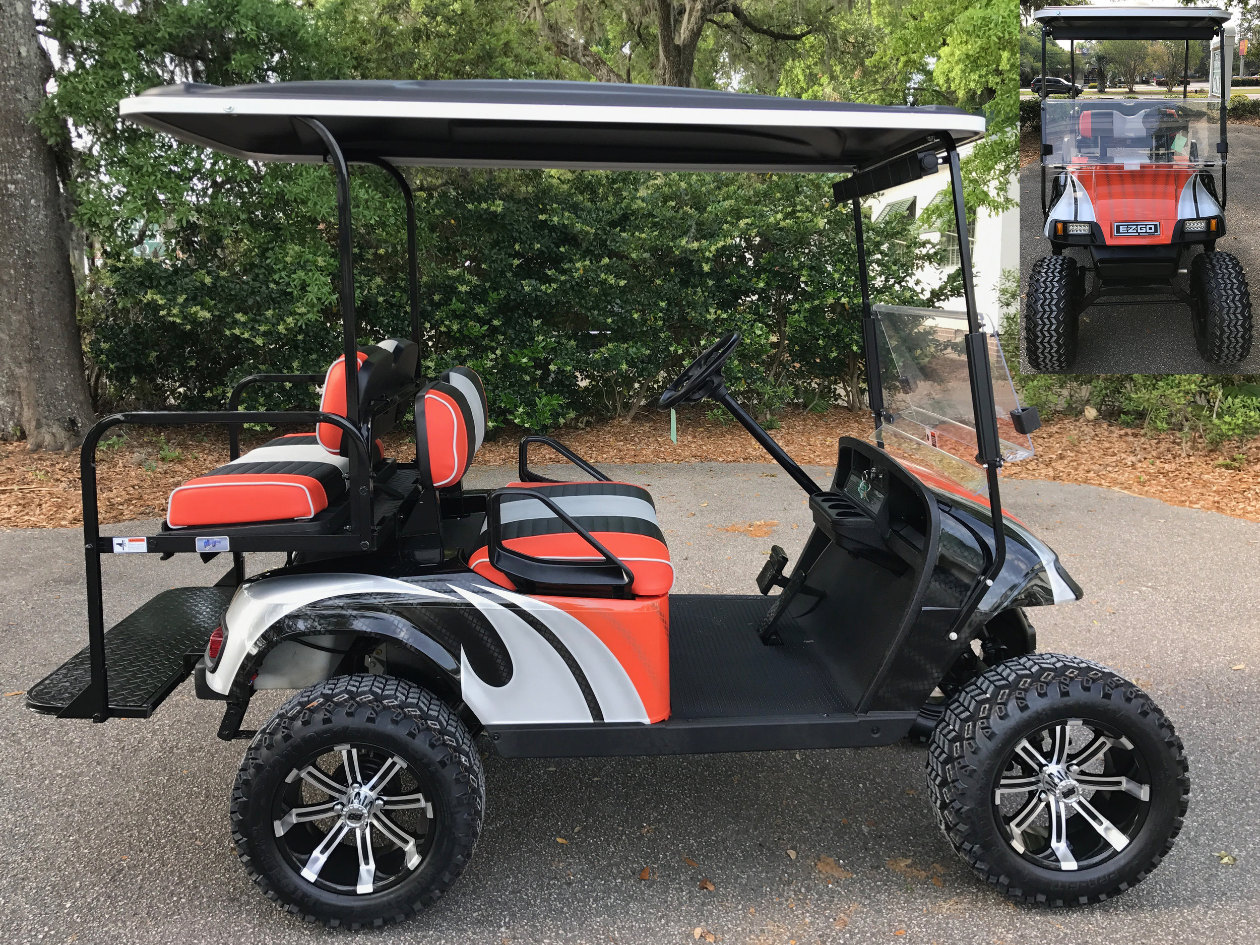 Orange Swirl EZGO Lifted Cart  Orange/black/smoke seats, black extended top, new batteries, high speed code, LED lights, Backlash (23x10x14) tires, mirror, flip windshield, and state of charge meter
