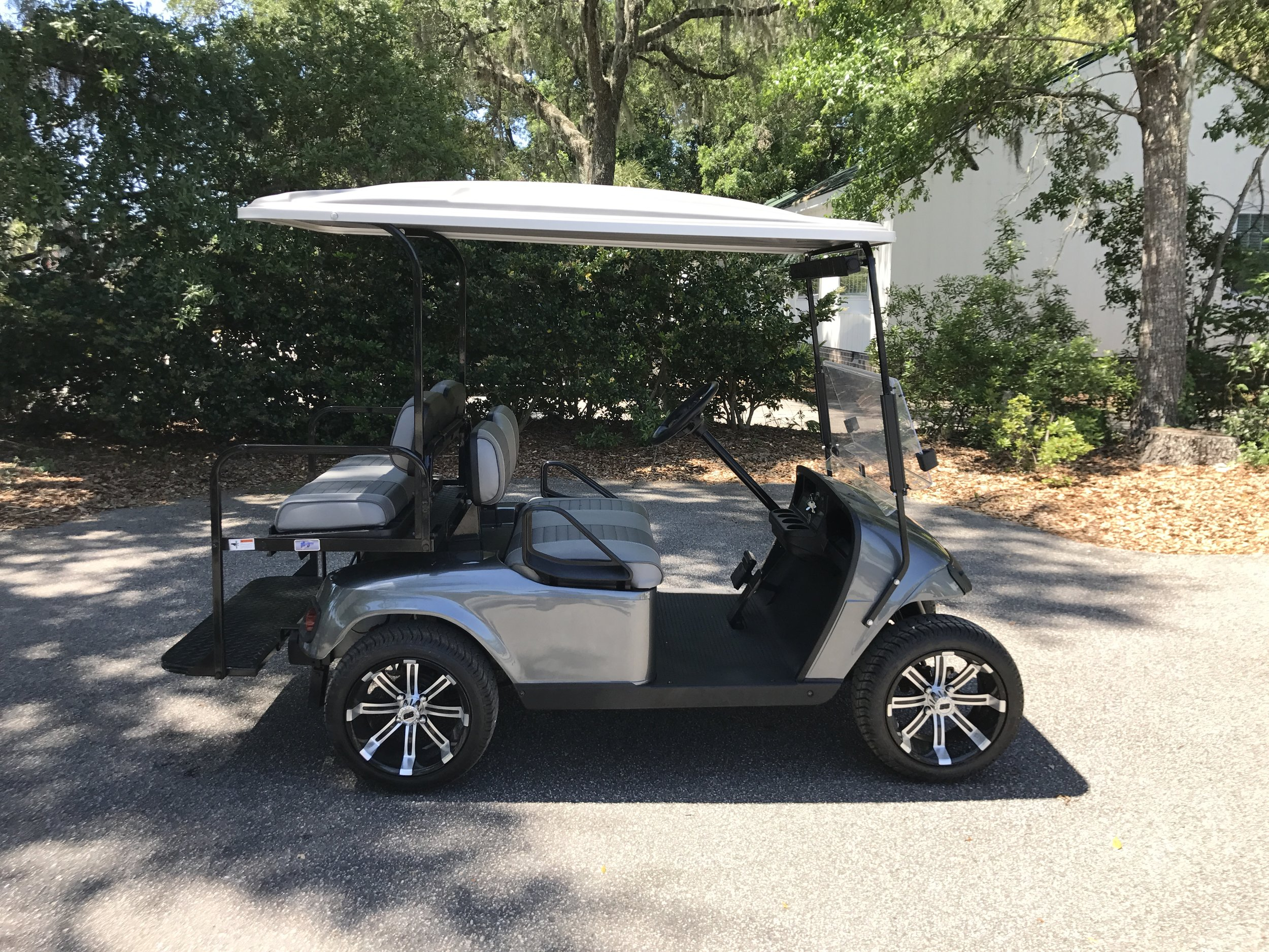 2015 Charcoal EZGO Cart —————  Charcoal/gray seats, gray extended top, new 2019 batteries (6-8vt), high speed code, LED lights, Lo Pro tires, mirror & flip windshield