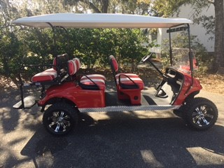 2015 RED EZGO Lifted Trolley ——-  Red/white seats, white top, new (2019) batteries 48vt (6-8), high speed code, LED lights, Backlash (23x10x14) tires, state of charge meter, mirror & flip windshield